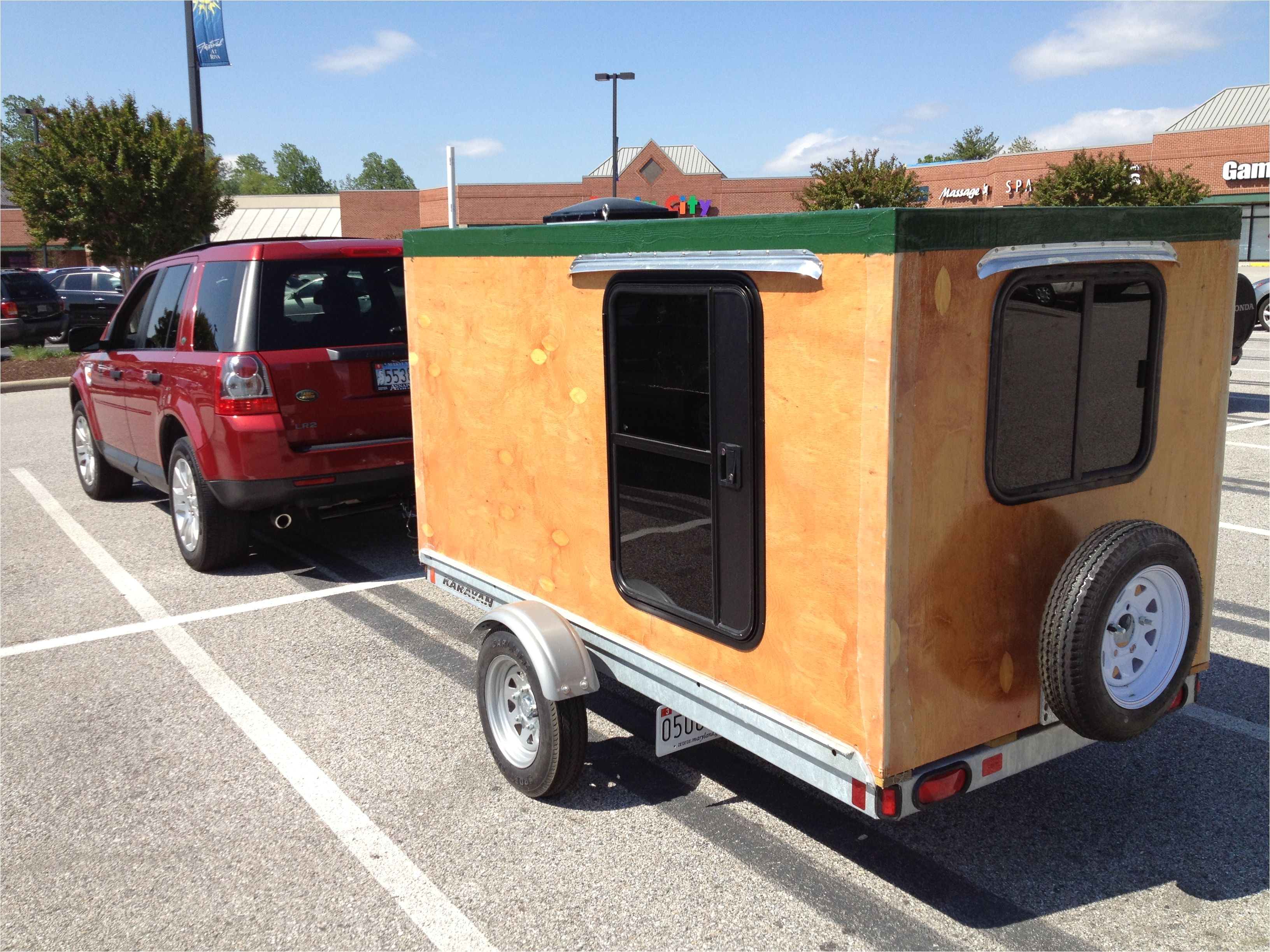 my homemade camper not very aerodynamic but lots of room inside to carry stuff