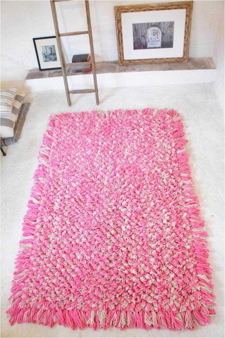 p a l o m i t a hand loomed wool boucle area rug in h o t p i n k