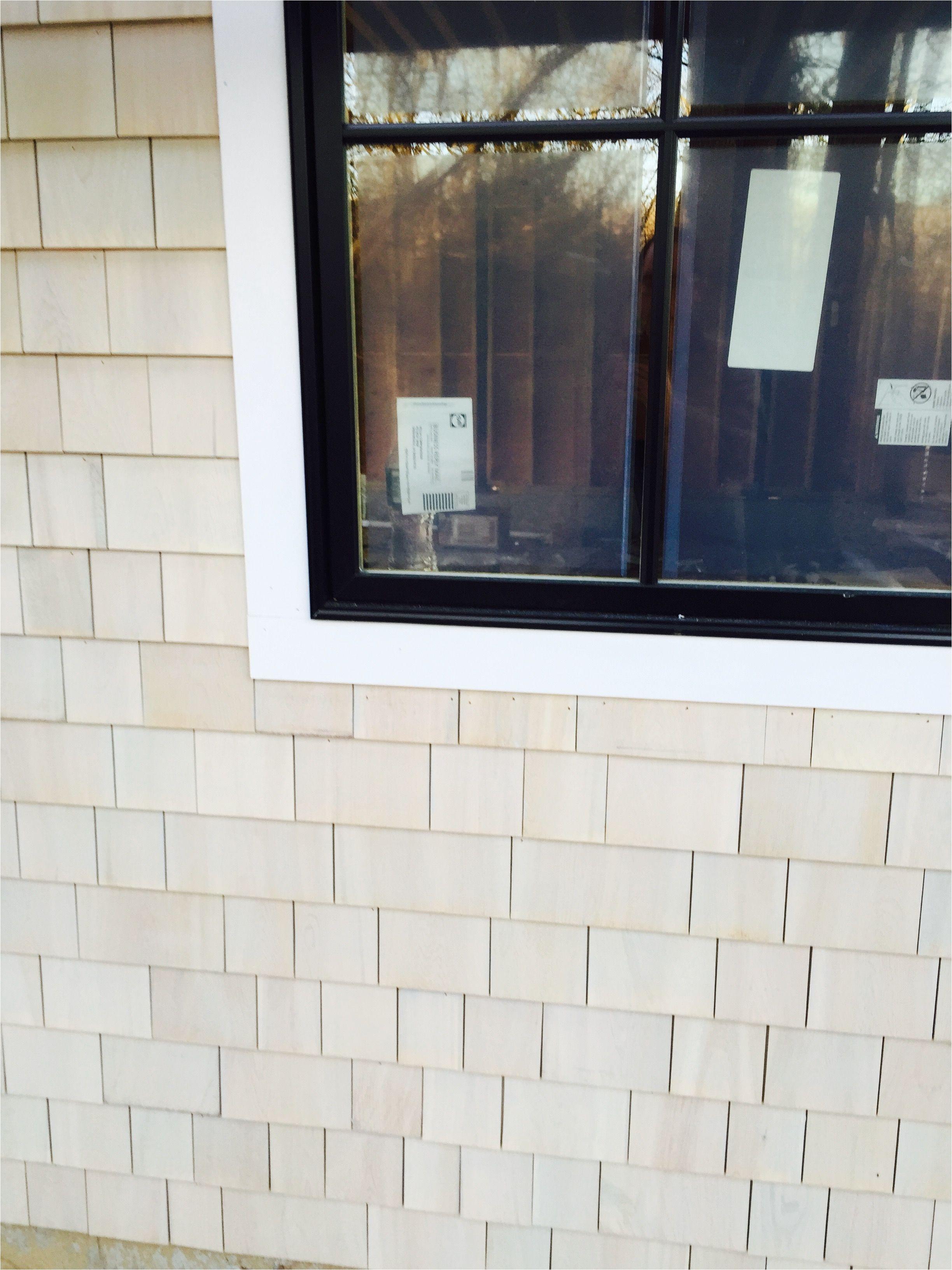 maibec white cedar shingle with bleaching agent next to pella casement window with black finish