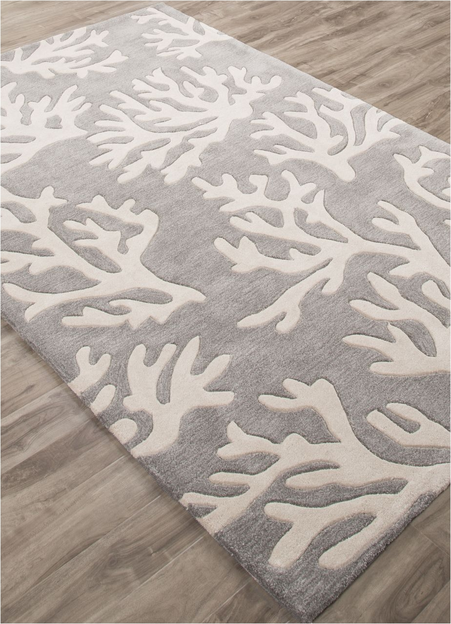 the coral branch pattern is created with carved details on this plush hand tufted polyester rug