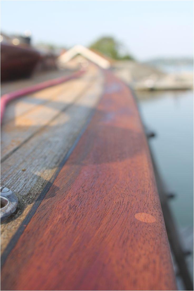 wooden sailboat repair work before sailing season mahogany parts of deck sweden 2014