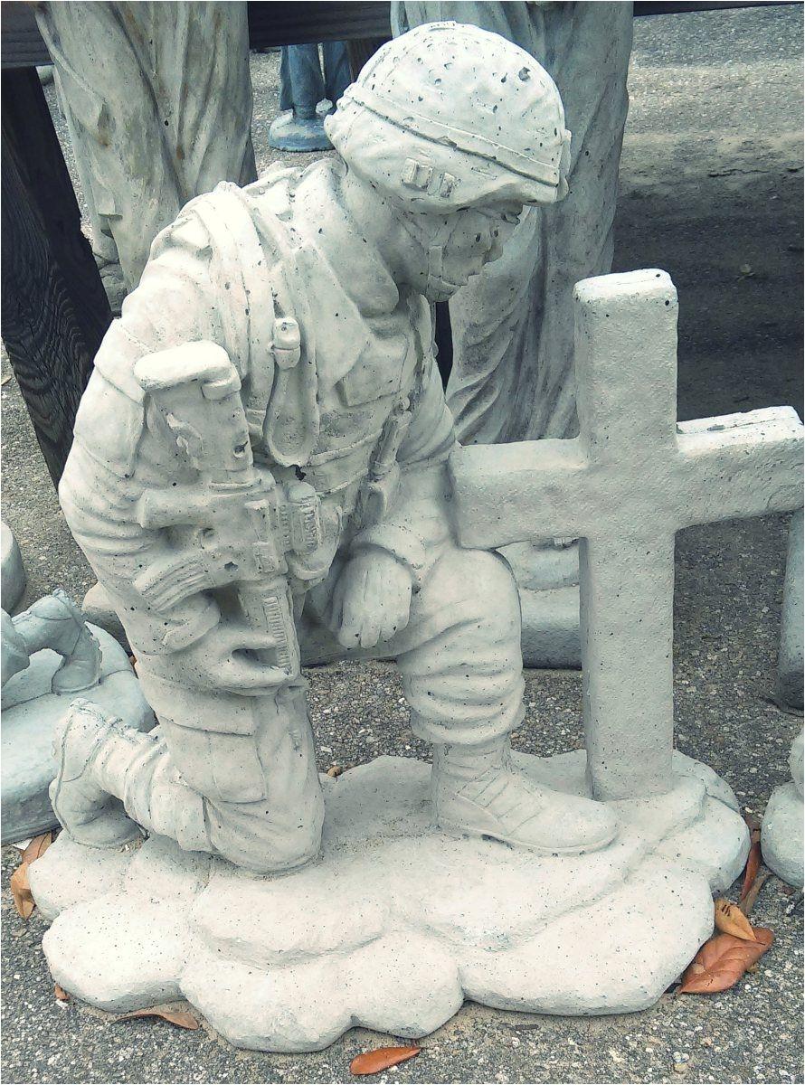 soldier kneeling at cross concrete garden art in tallahassee florida