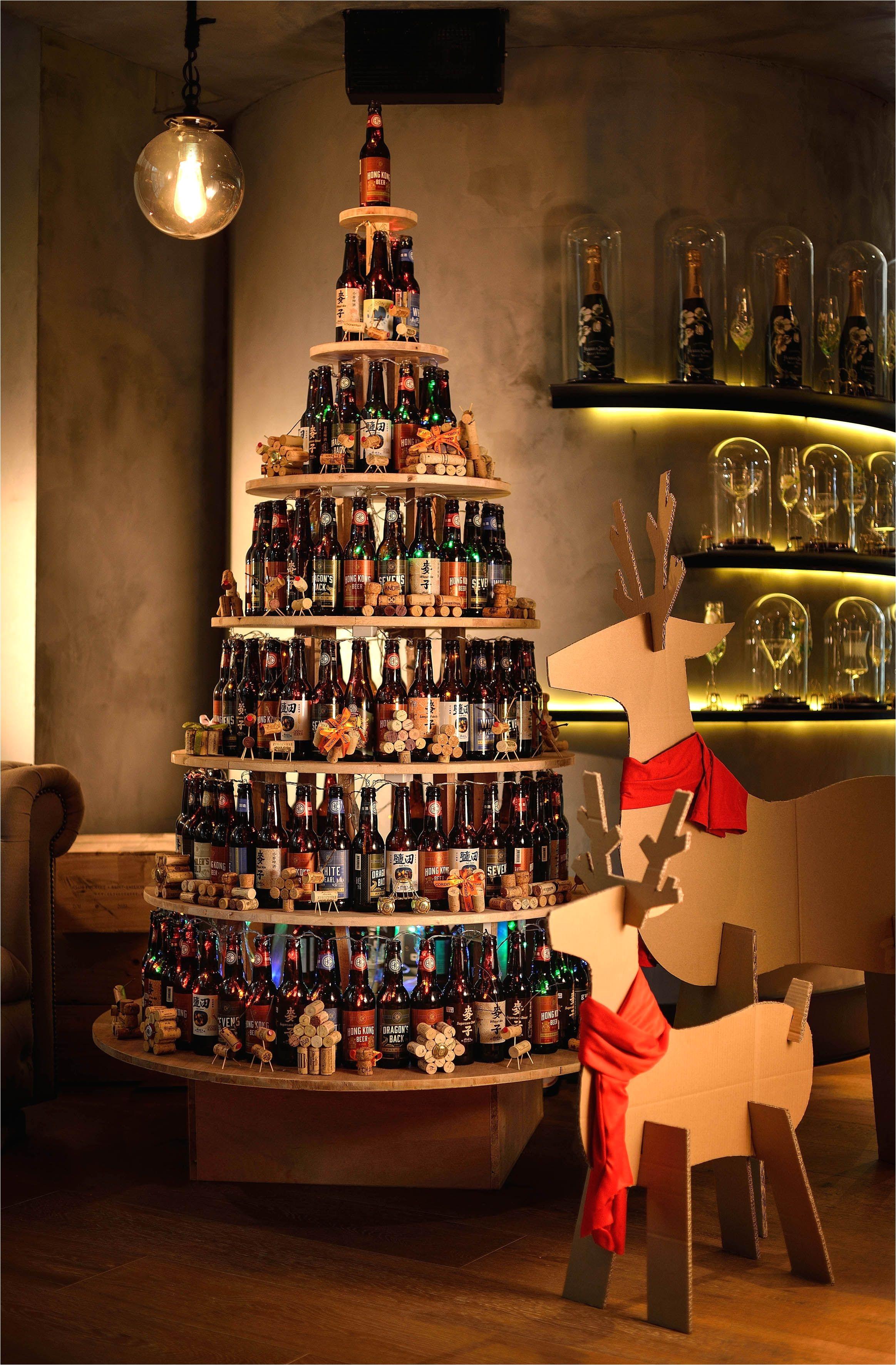 cordis hong kong s sustainable christmas tree was created by stacking 170 used local hong kong