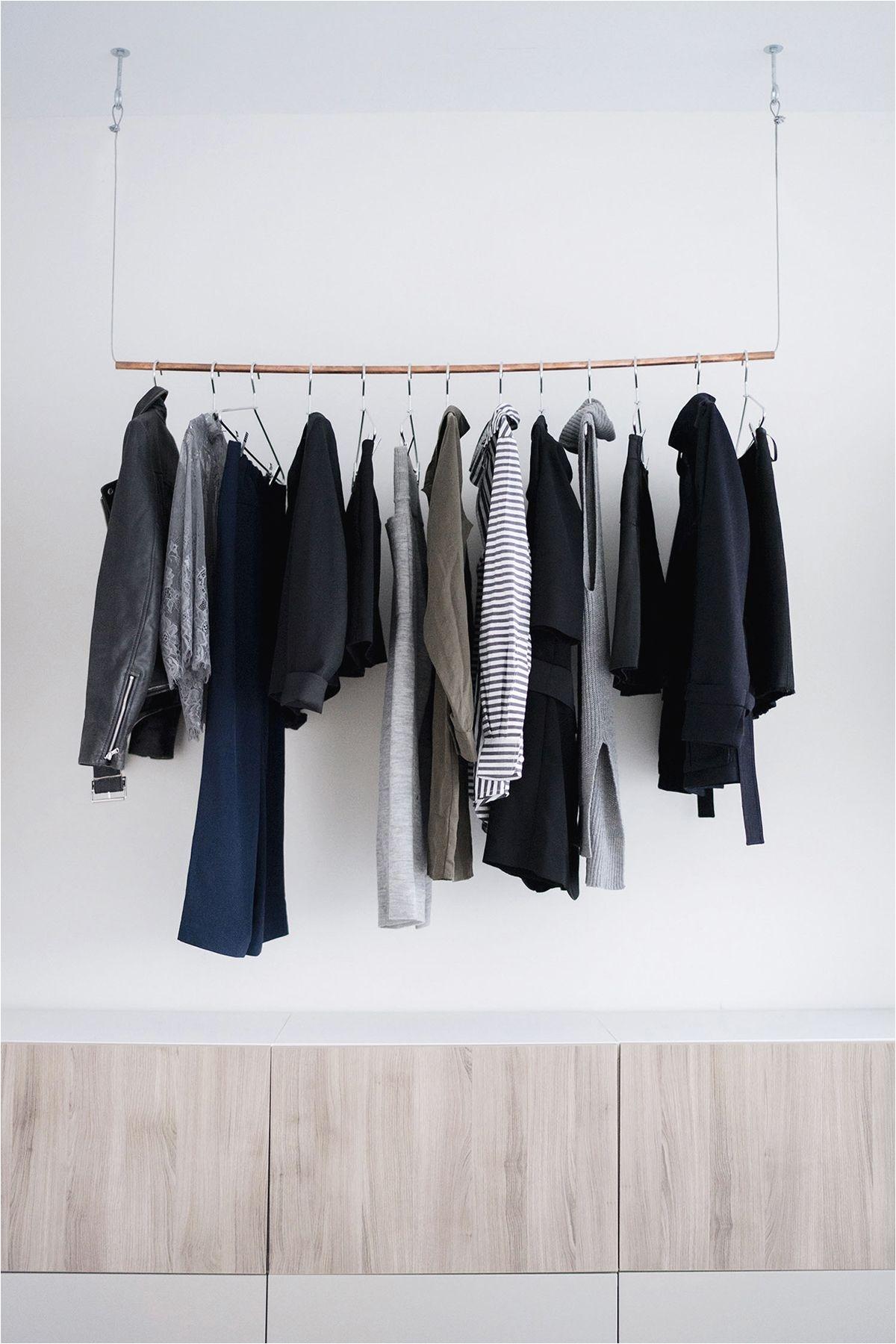 ikea besta wall unit copper pipe hanging clothes rack scandinavian industrial bedroom in new york city