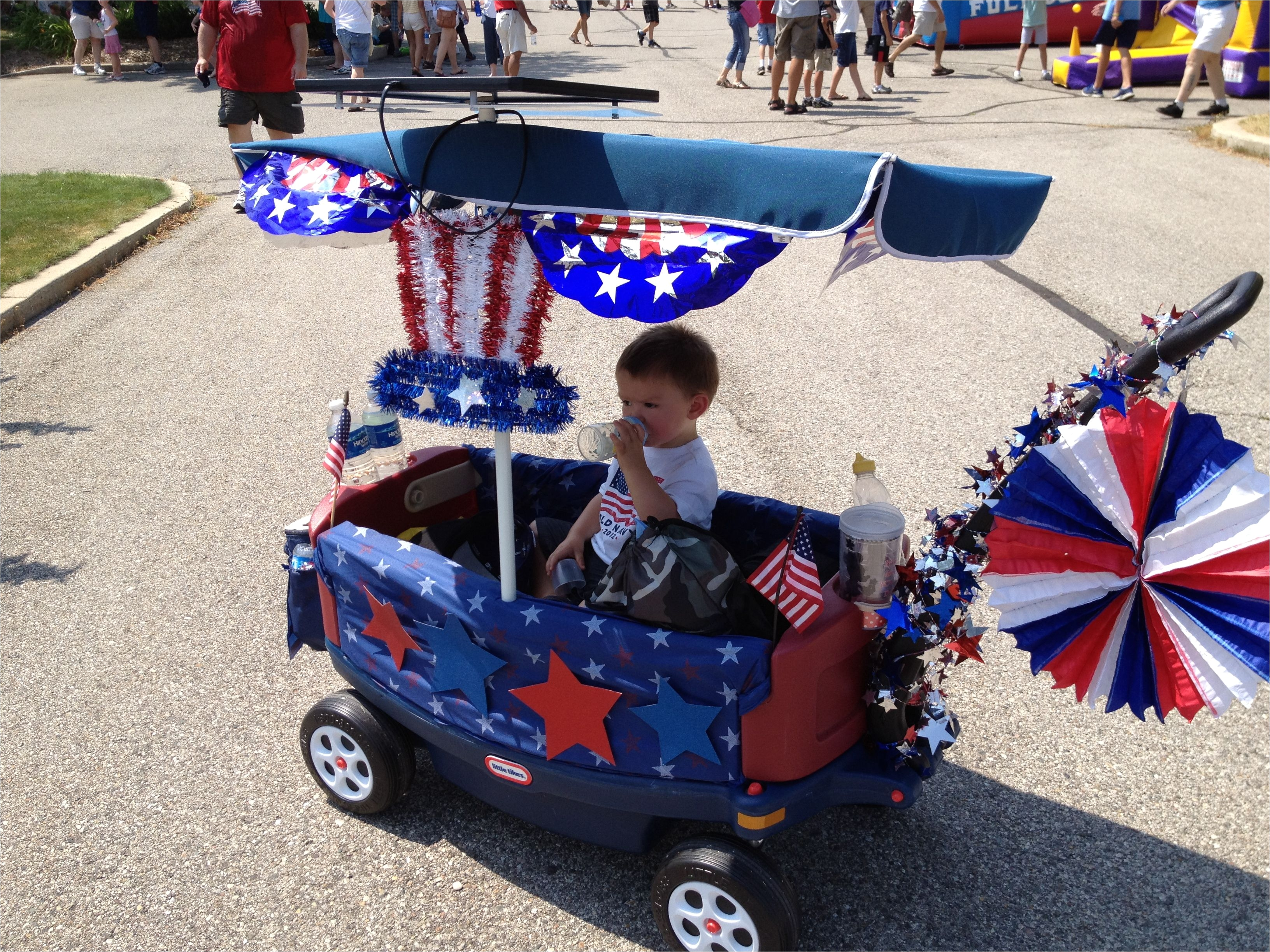 4th of july decorated wagon best part is the solar panel on top of the canopy that connects to fan hanging under canopy
