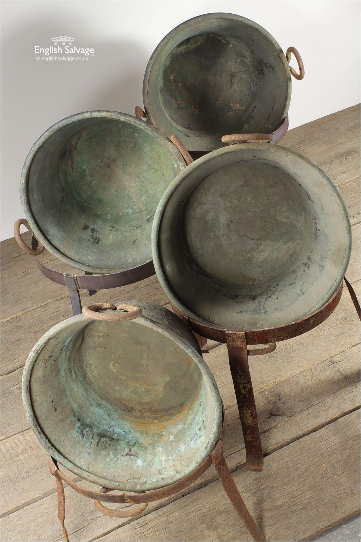 reclaimed vintage copper pots on stands