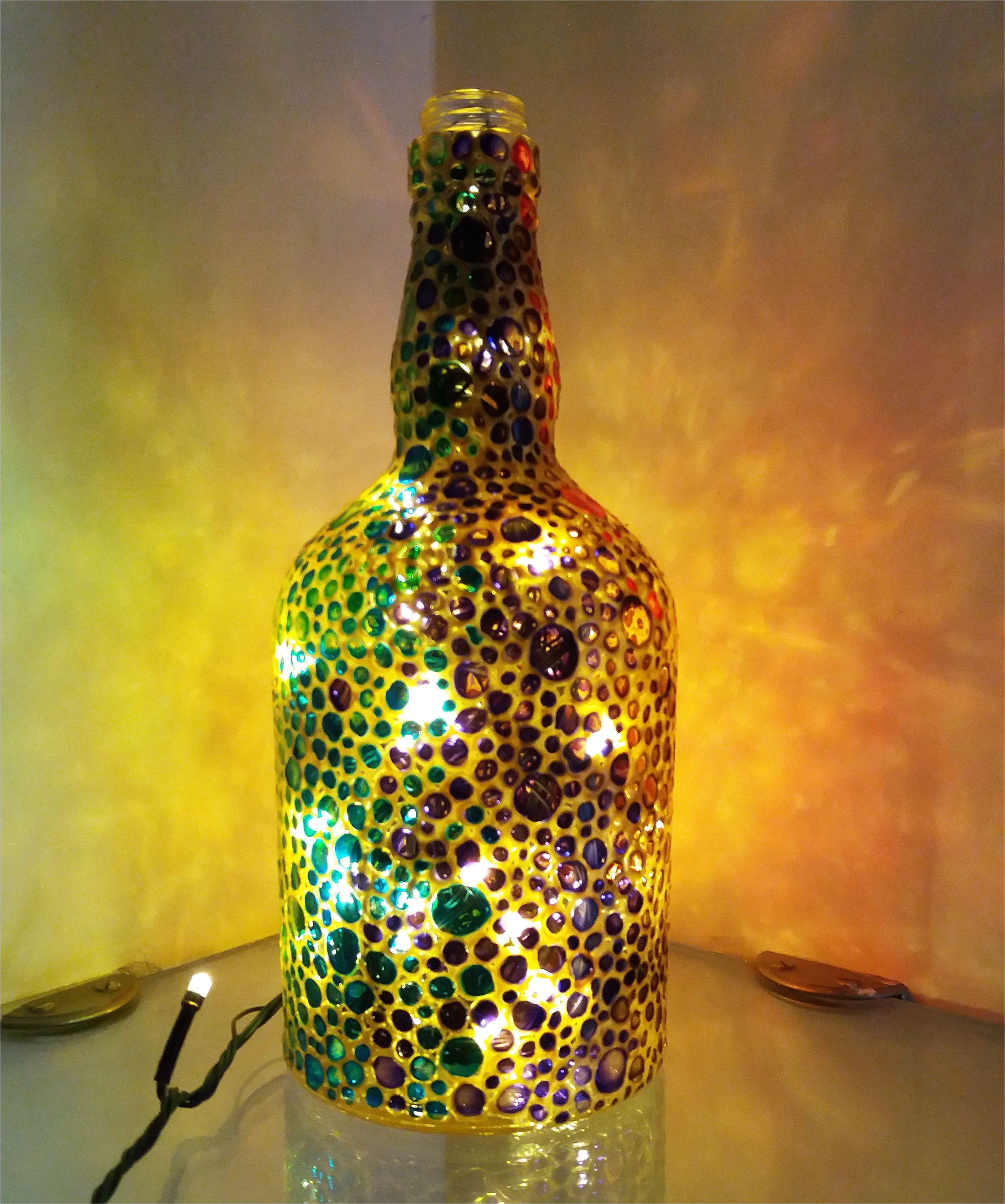 hand painted recycled glass bottle with lights this bottle is painted with glass colors it s a great way to decorate your living room or bedroom specially
