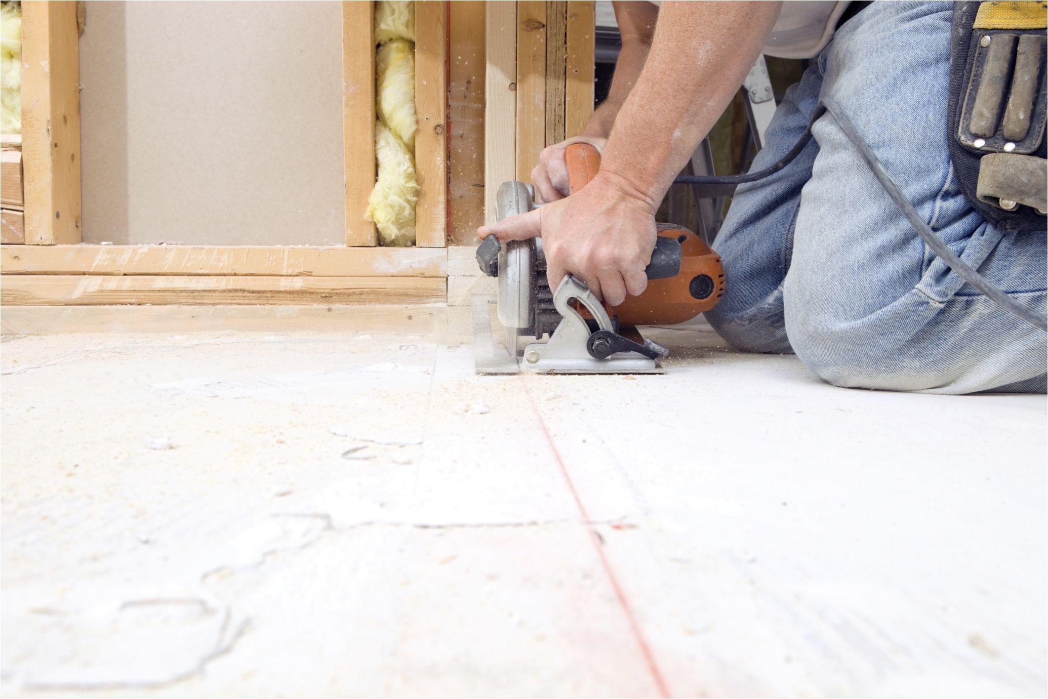 cutting plywood subfloor with circular saw 185001220 56a4a04b5f9b58b7d0d7e37f jpg