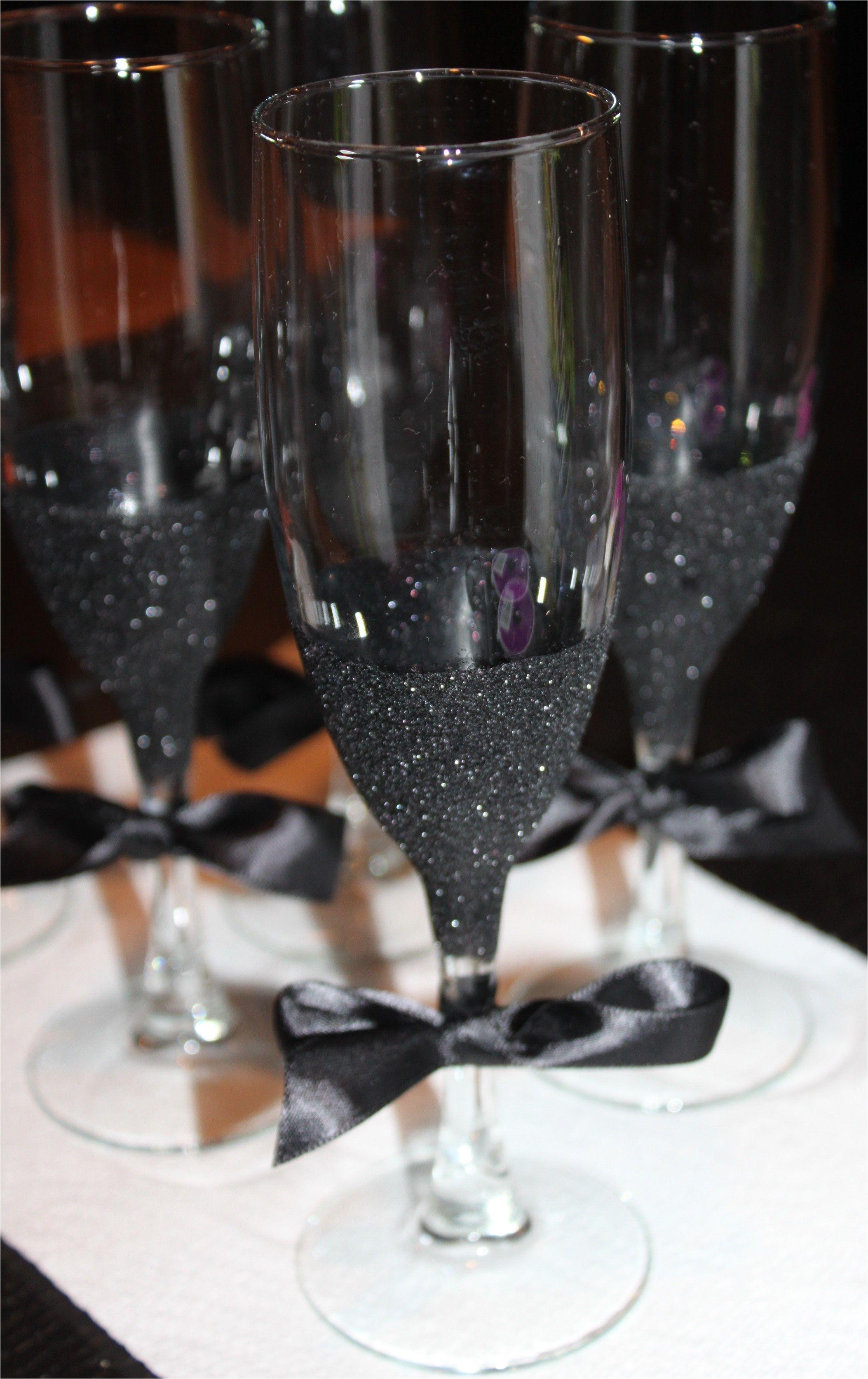 diy black glitter champagne flutes use glue paint brush black glitter and a