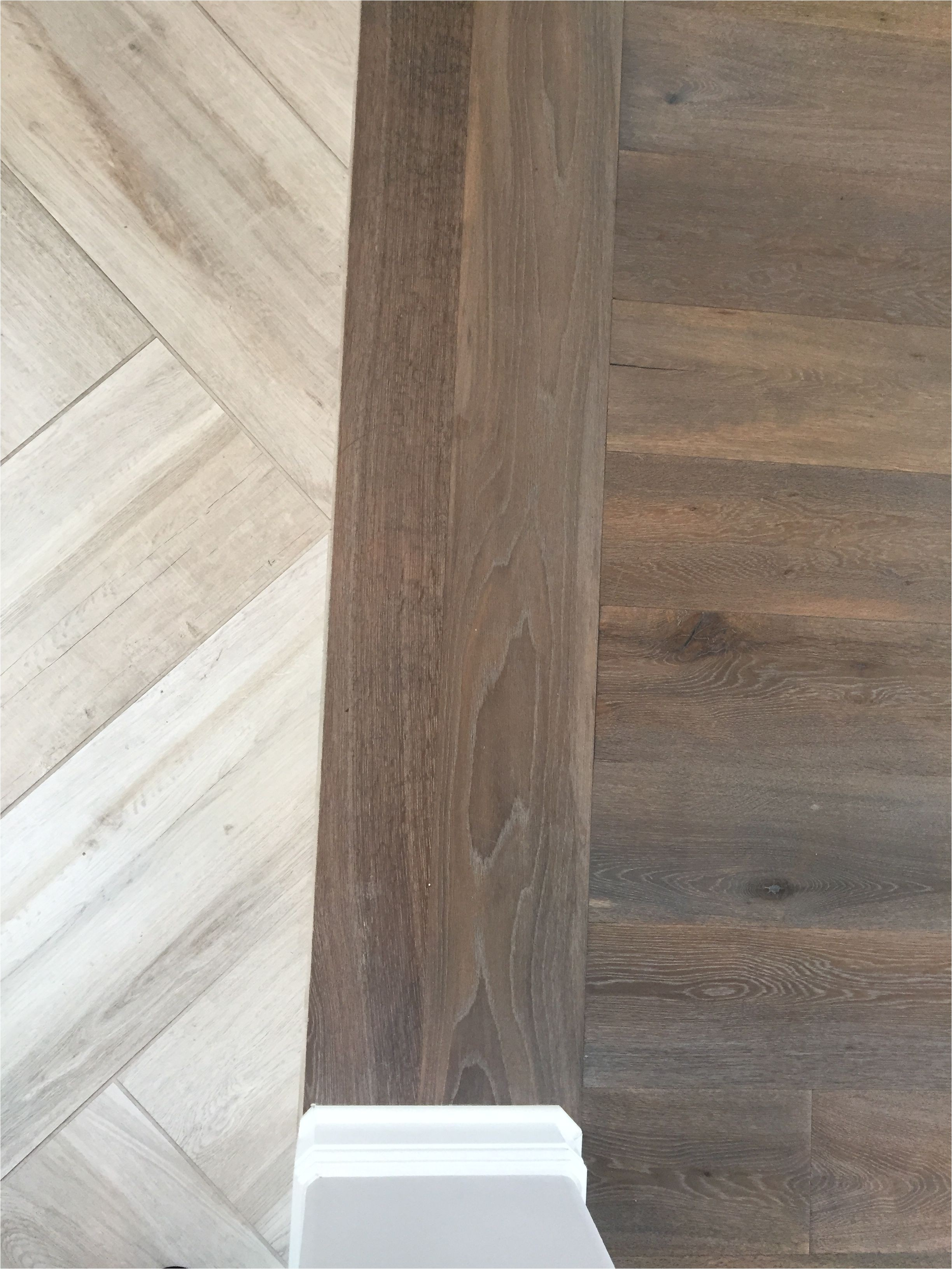 floor transition laminate to herringbone tile pattern