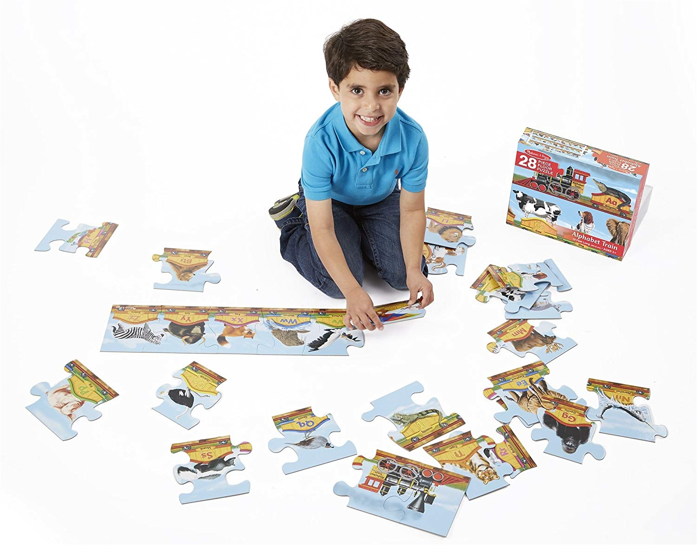 amazon com melissa doug alphabet train jumbo jigsaw floor puzzle letters and animals 28 pcs 10 feet long melissa doug 28pc 424 toys games