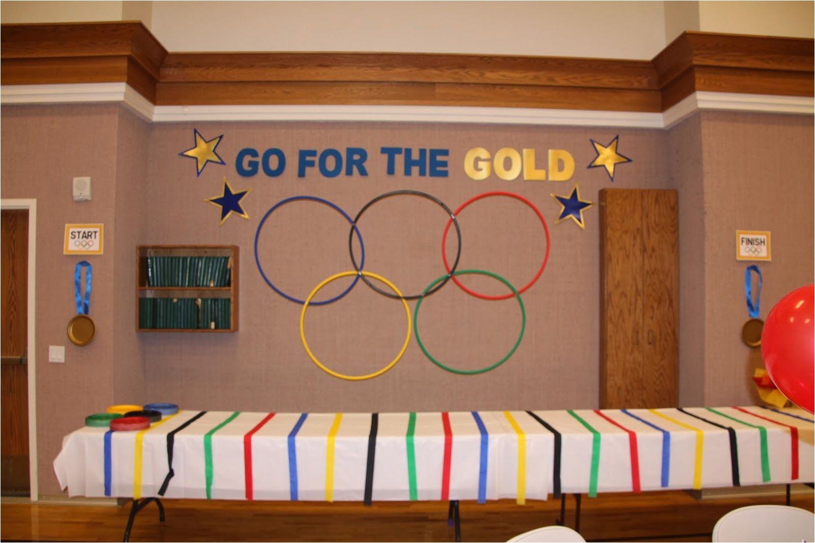 go for the gold olympic themed blue and gold banquet