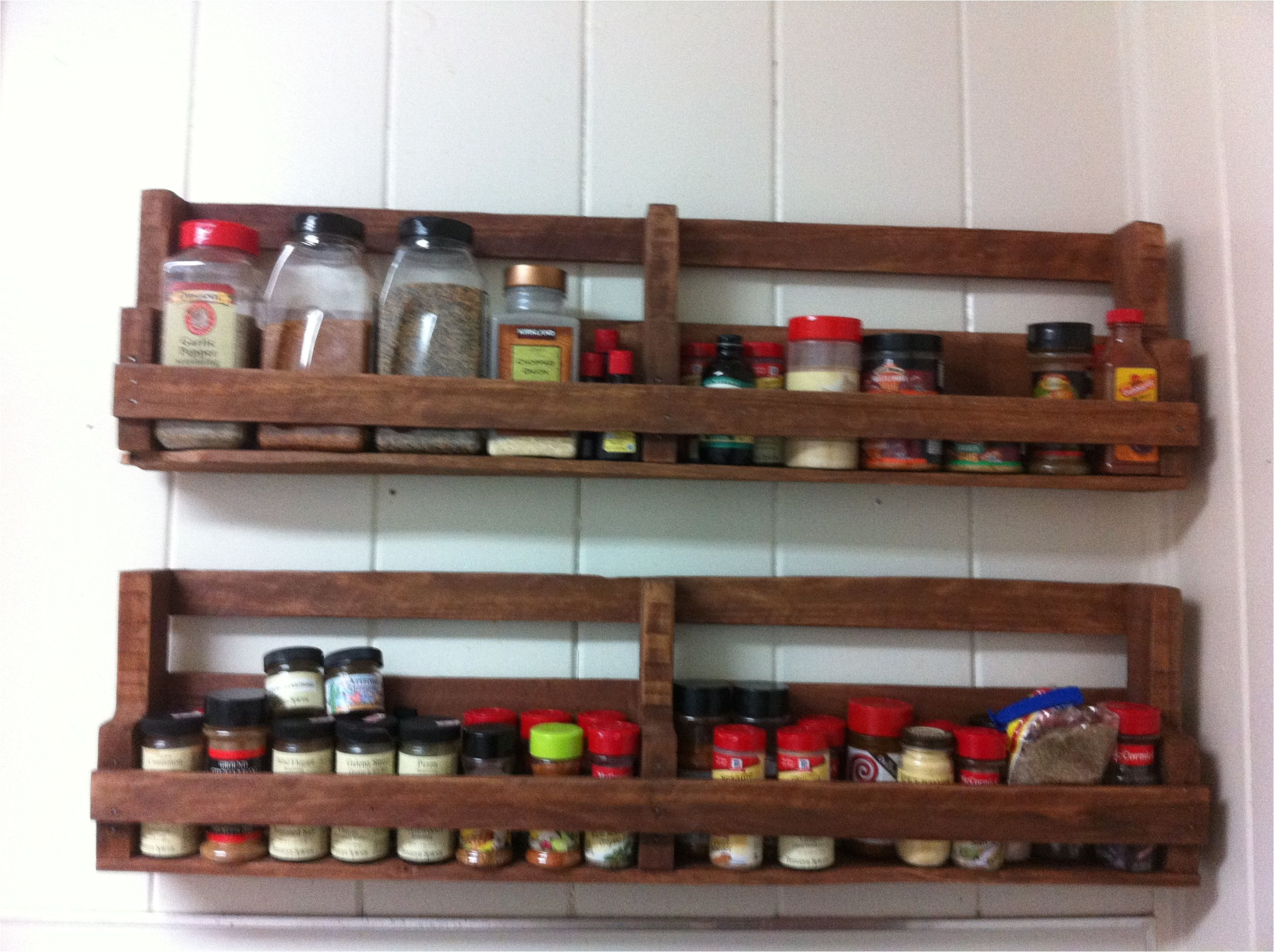 a home made spice rack made out of pallets