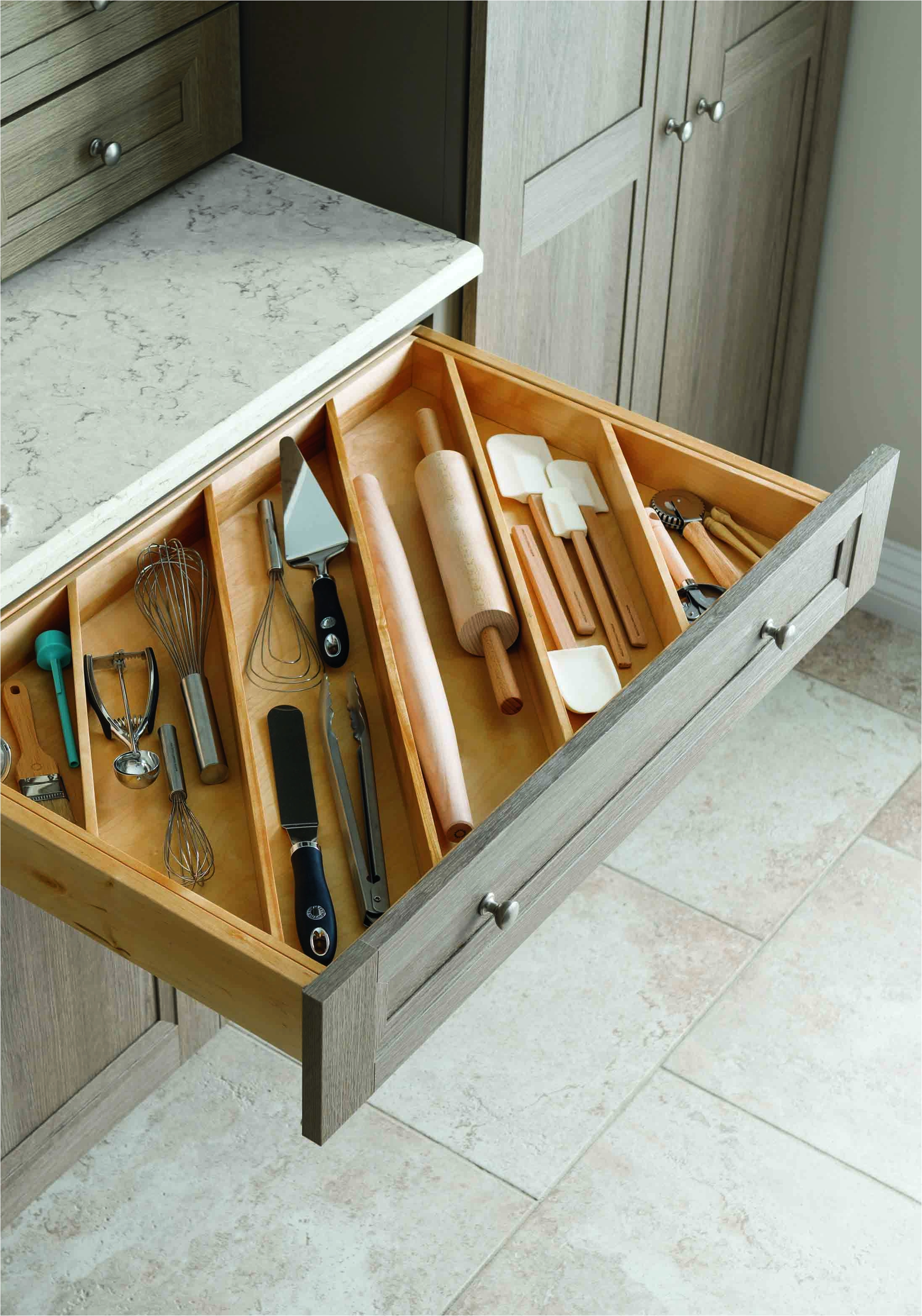 kitchen storage tip store your utensils diagonally instead of flat in vertical or horizontal slots a diagonal insert makes a smarter more efficient use
