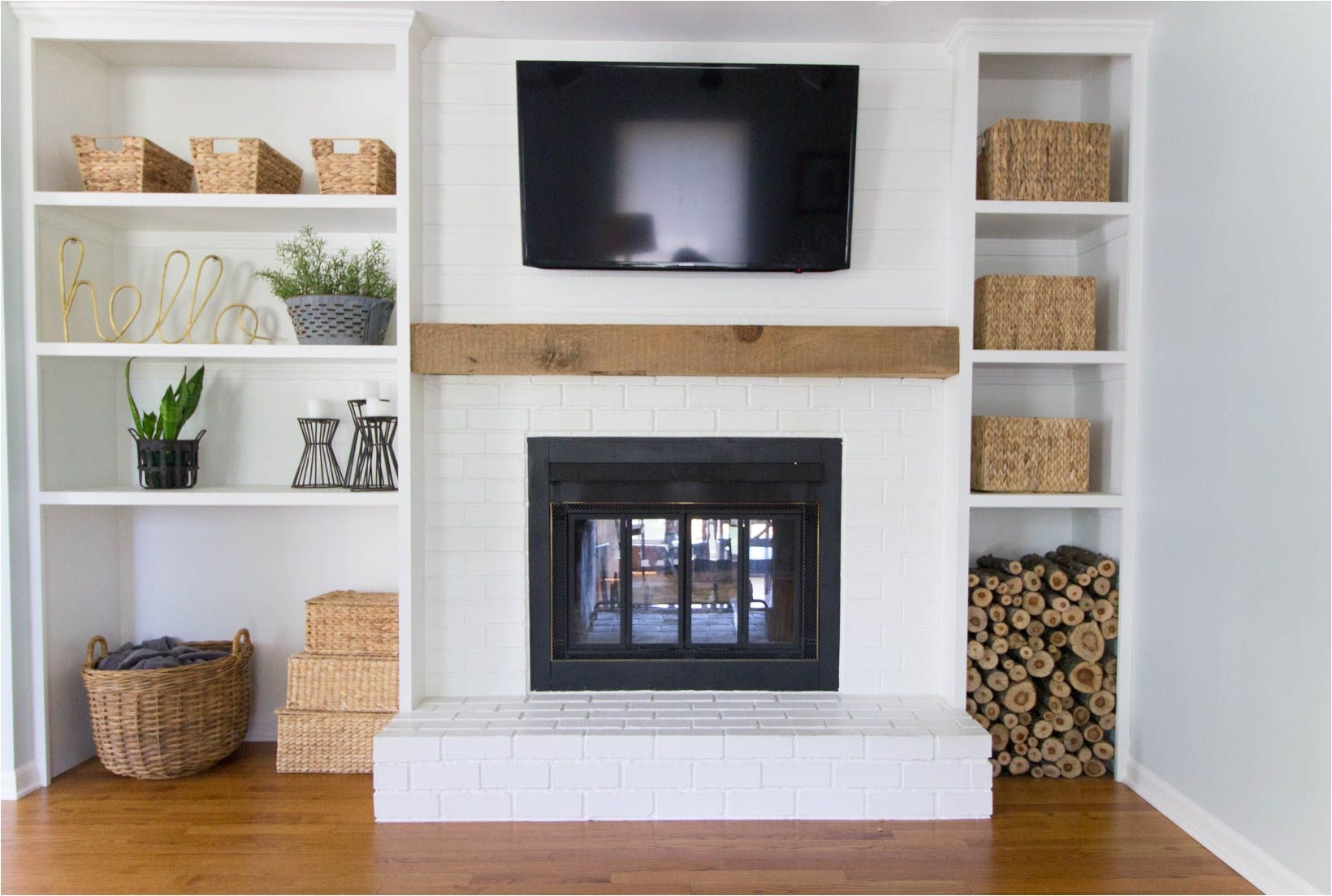 built in shelves around shallow depth brick fireplace
