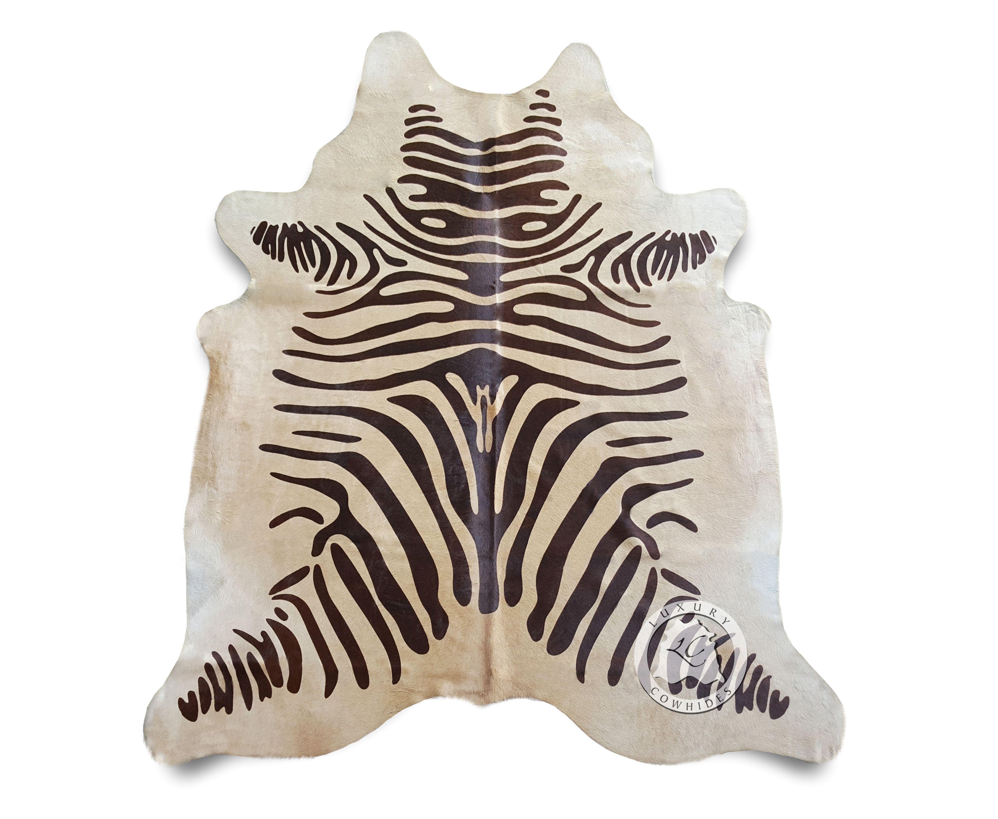 zebra brown stripes on beige cowhide rug