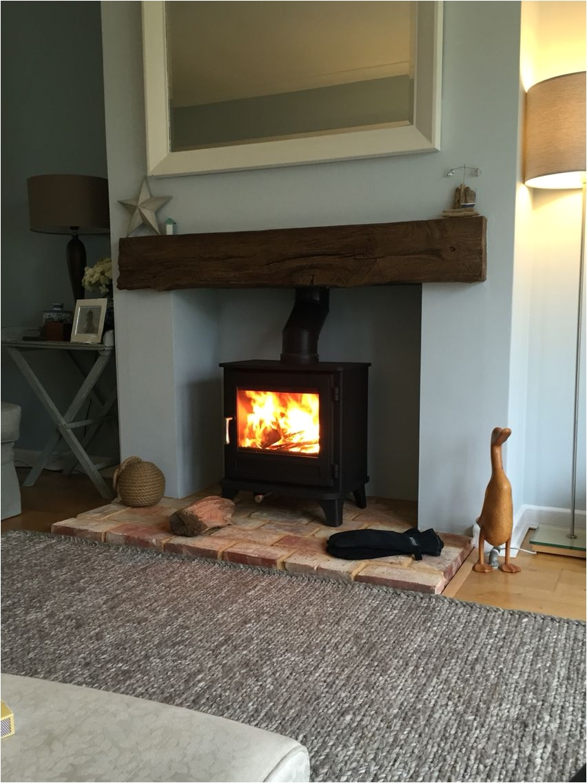 chesney log burner timber effect beam grey rug reclaimed brick hearth