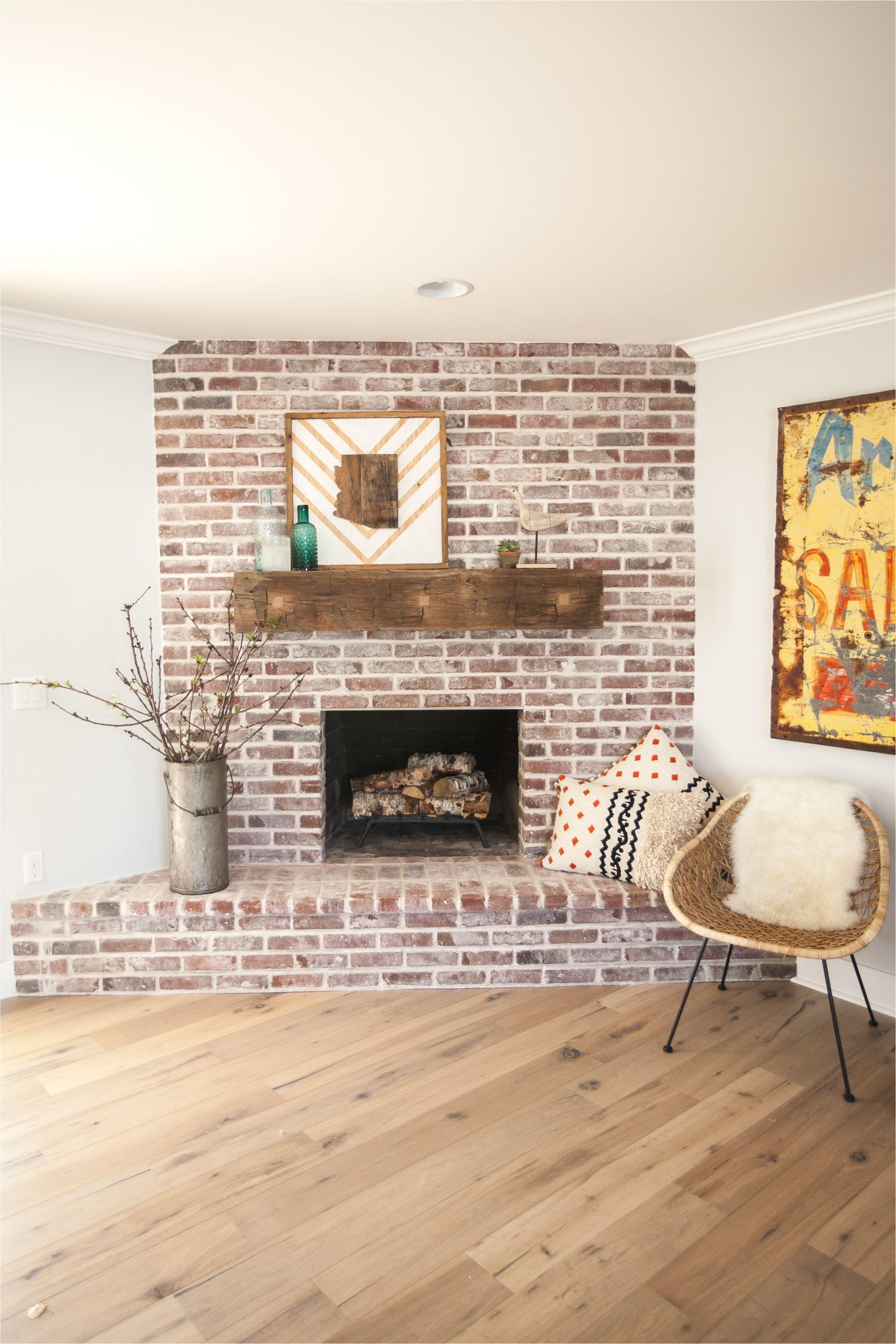 chic whitewashing brick fireplace surround with custom brick fireplace with antique white mortar and custom