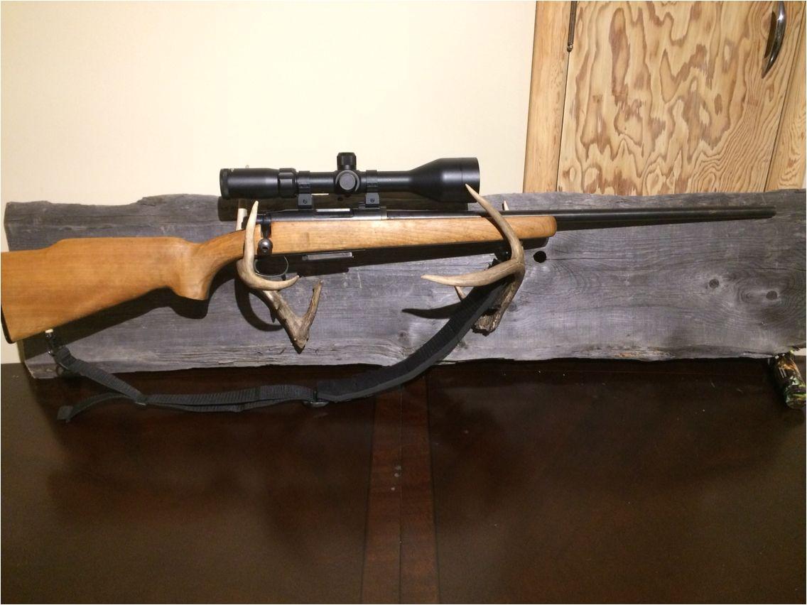 white tail deer antler barn wood gun rack