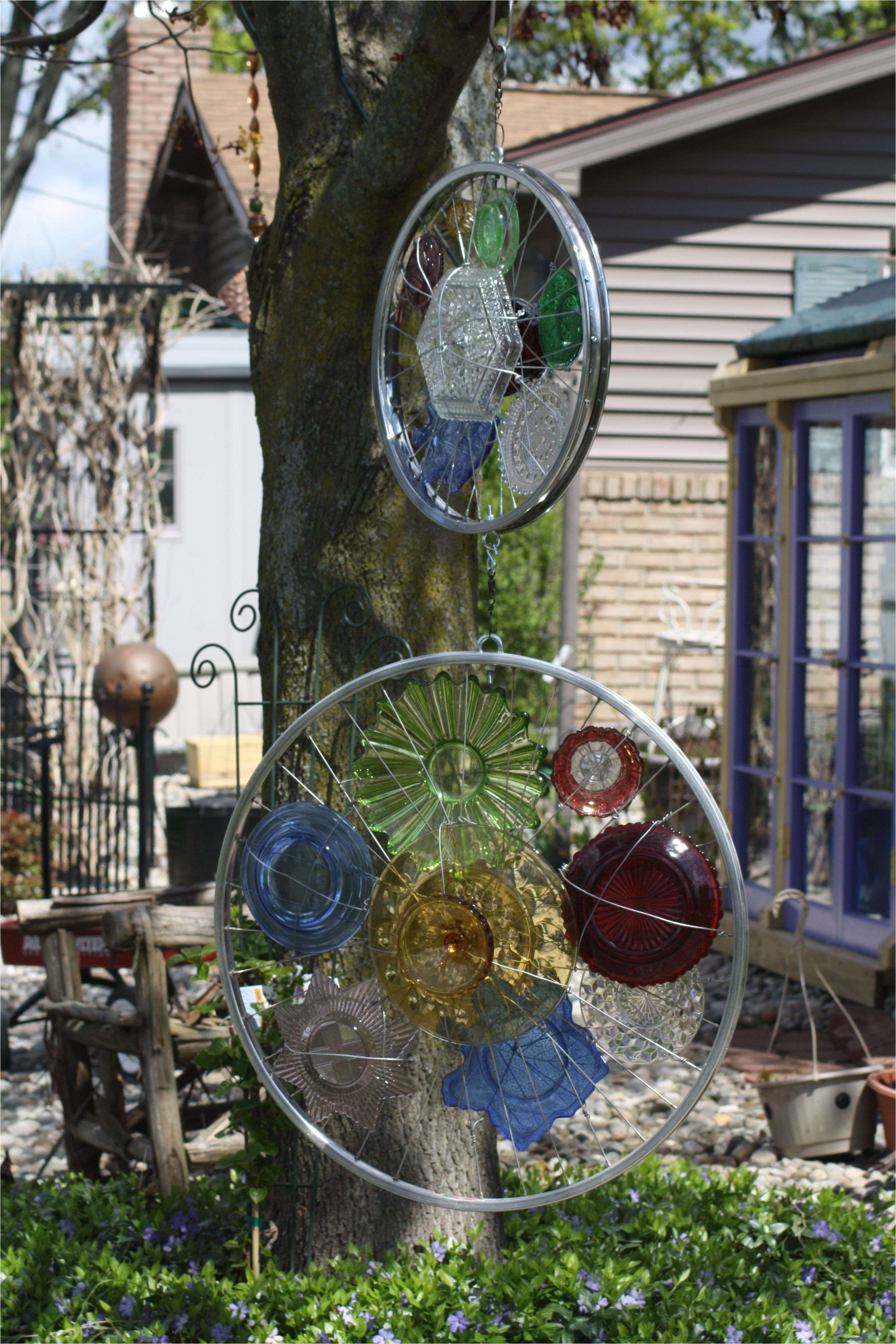 bicycle garden decor ideas 2 bicycle rims feature interesting colored glass pieces each will turn separatly in the wind yard
