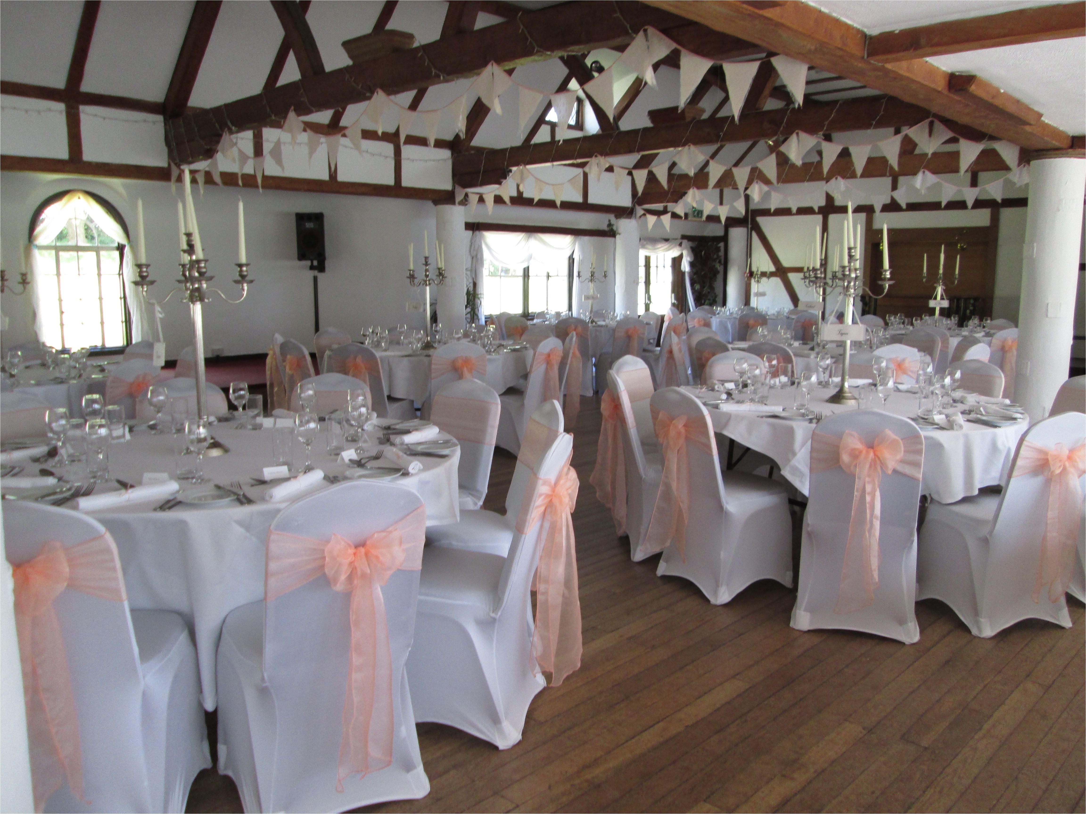 peach table cloth white chair cover peach sash reception google search