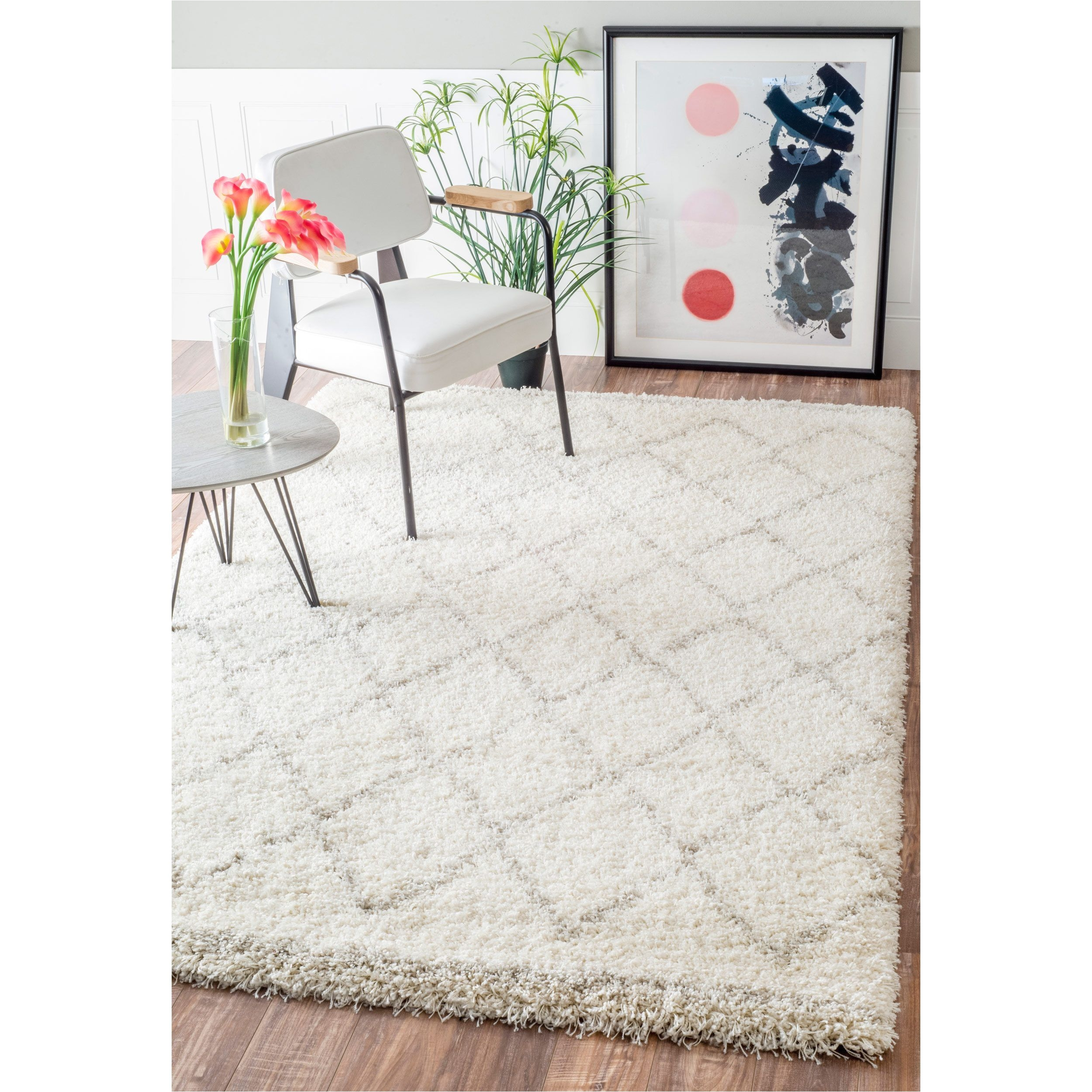 inspired by moroccan berber carpets this trellis shag rug adds depth to your decor made of polypropylene this soft and plush shag rug feels great under