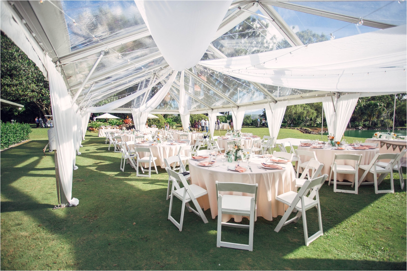 Tent Table and Chair Rentals Near Me 30×60 Clear top Tent with Wheel Style Cafe Lights and Swag Draping
