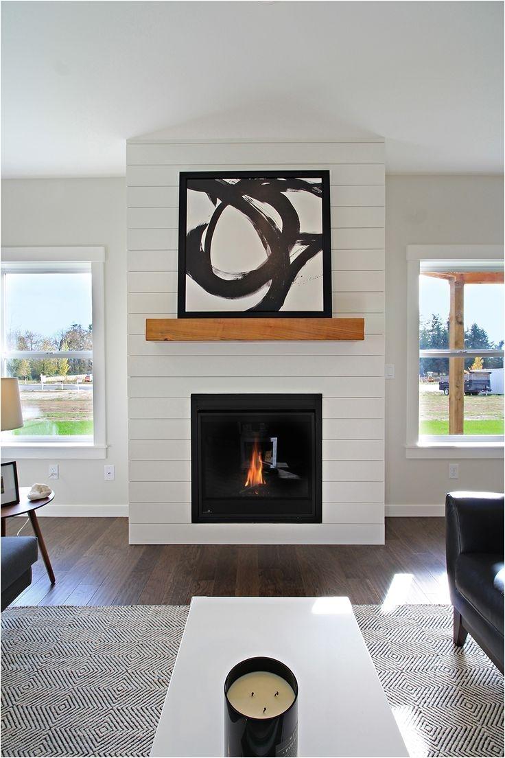 white shiplap fireplace surround with wood mantle woodsman 11 west coast homes