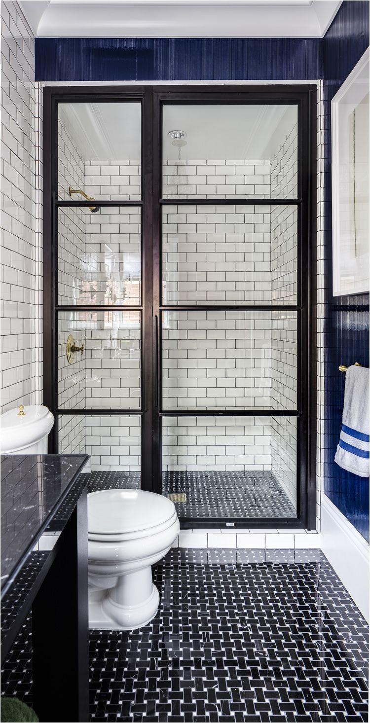 black glass paneled shower door evars anderson design
