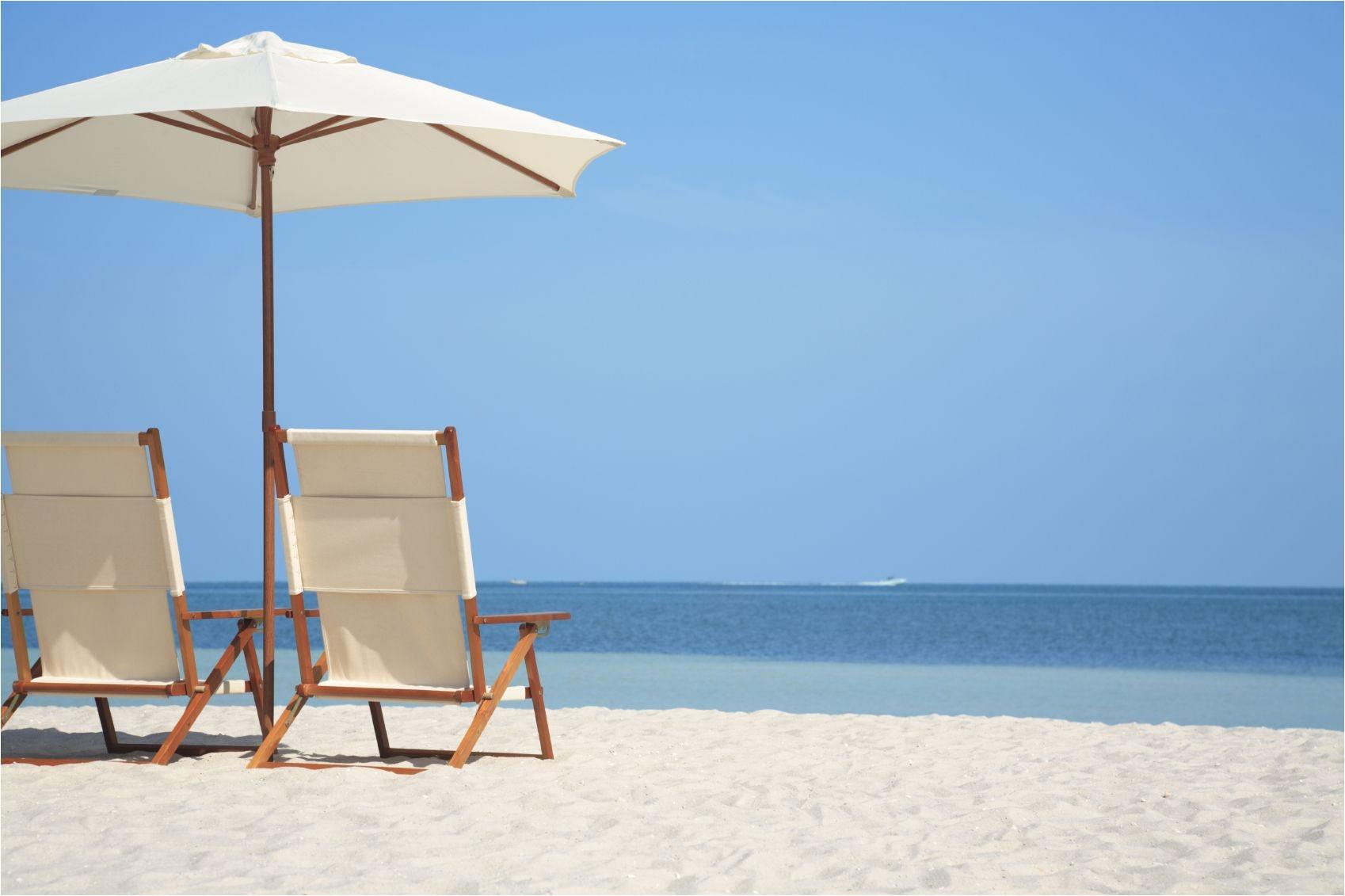 Sun Tanning Beach Chairs Beach Chair Beach Chairs and Umbrella On Tropical Beach Beach