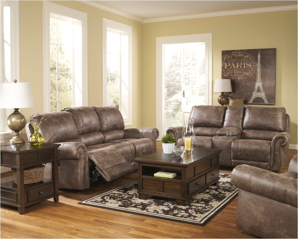 though ruggedly handsome the oberson reclining sofa is really a big softy offering the ultra cool look of battered leather without the cold leather feel