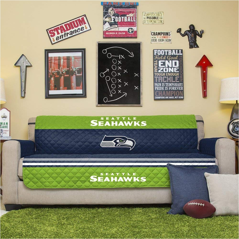 amazon com pegasus home fashions nfl seattle seahawks sofa couch reversible furniture protector with elastic straps 75 inches by 110 inches home