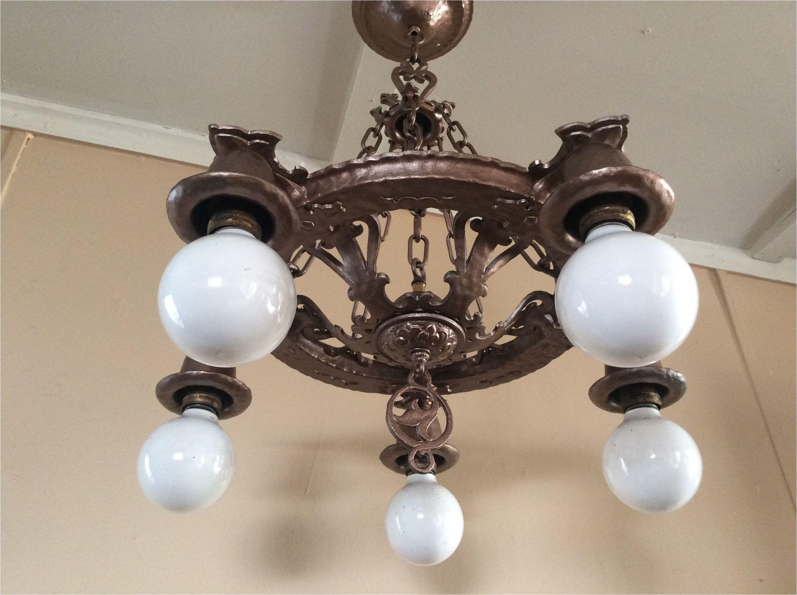 antique spanish revival hammered chandelier marked virden 1930 dragon or serpent heads