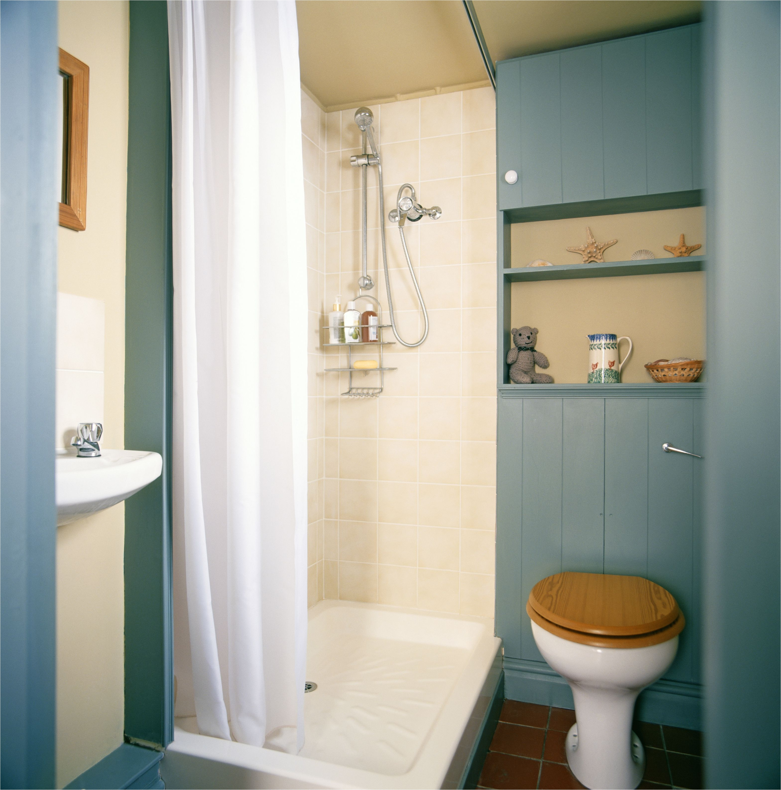 front view of a toilet in a neat bathroom 540033296 57b4d7eb5f9b58b5c2232d7d