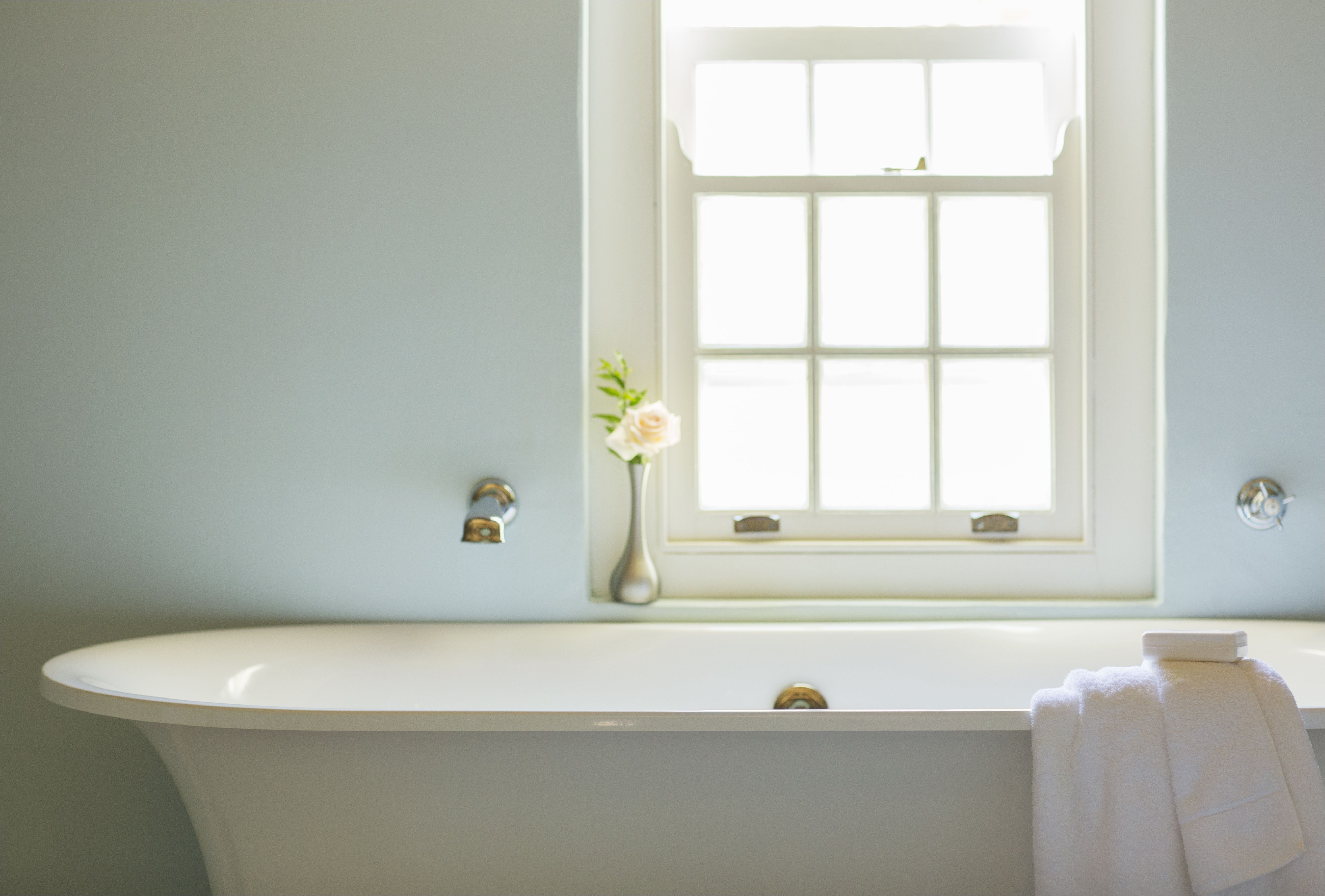 soaking tub below window in luxury bathroom 494358425 5aa1e931c064710037061882