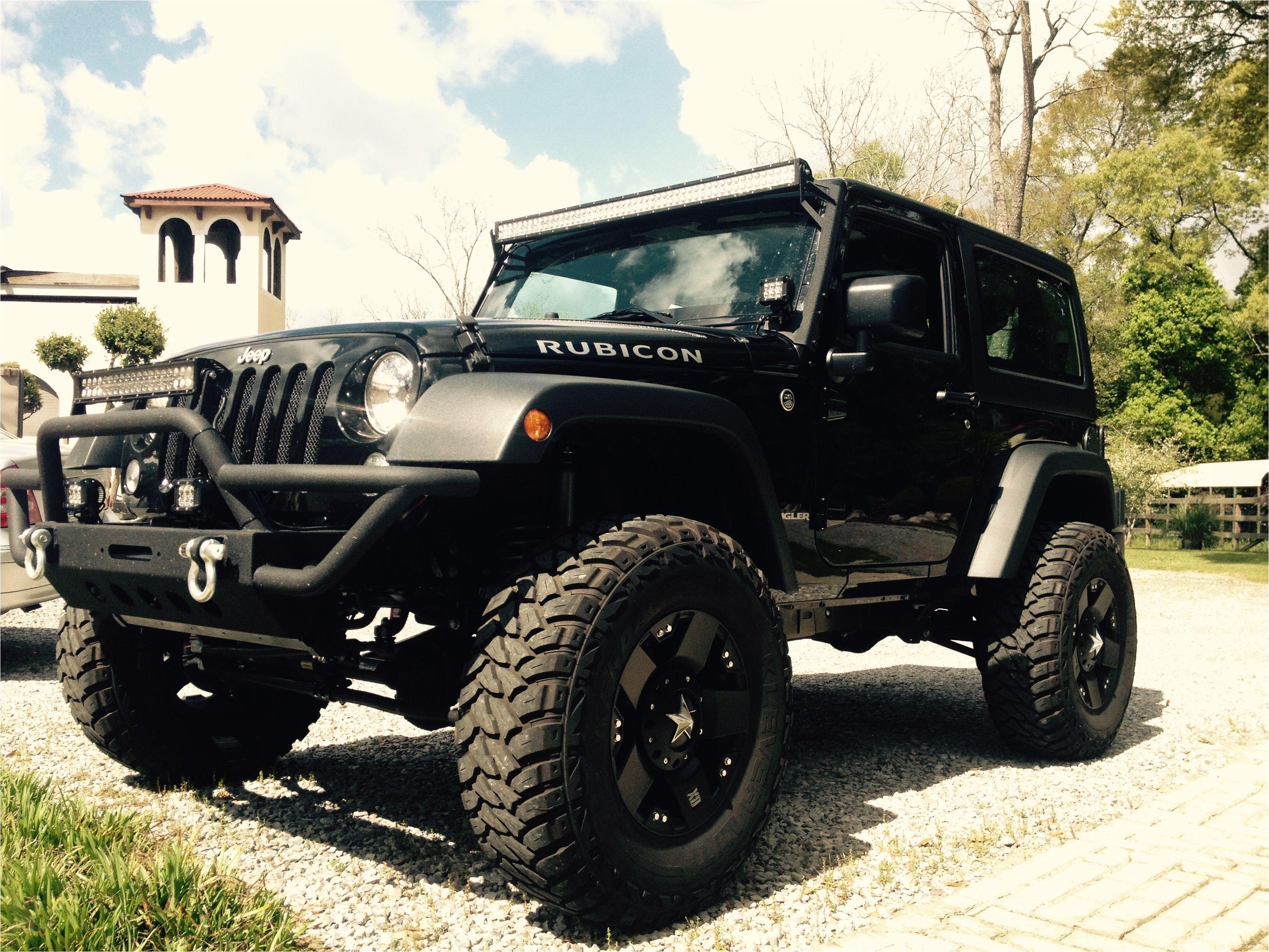 black jeep wrangler 2 door 4 inch lift 35 inch tires black rockstar rims 50 inch led light bar 24 inch led light bar led pod lights rubicon