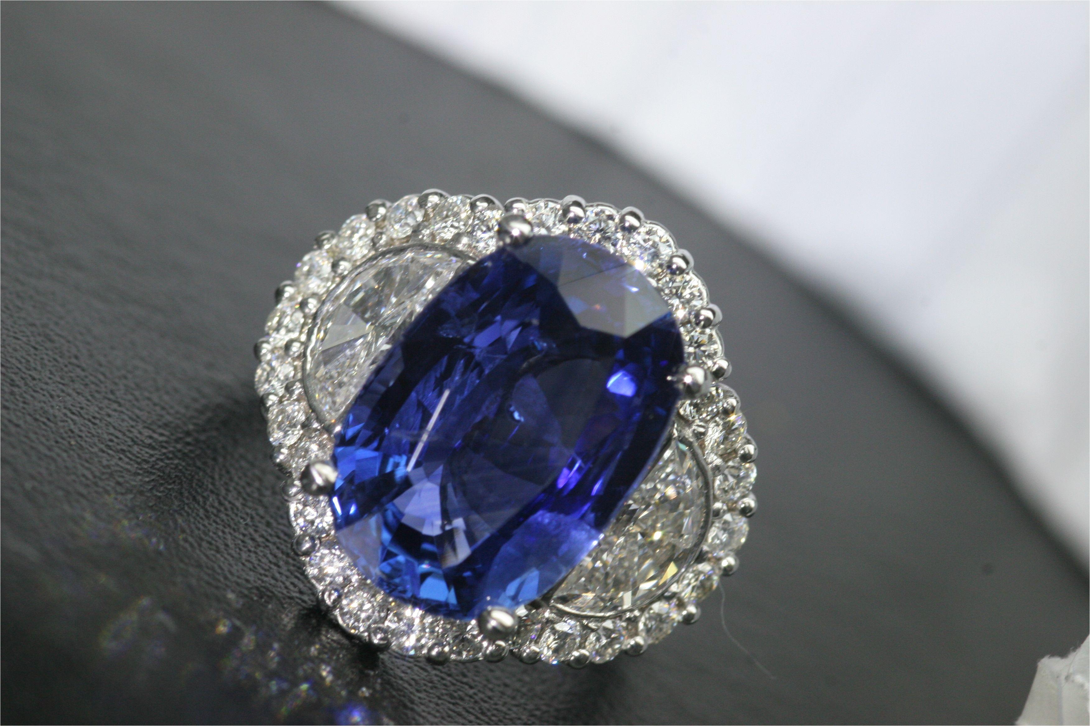 graceful engagement rings light blue diamonds on a 4 25 carat oval sapphire with halo od surrounding diamonds