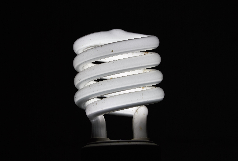 close up of energy efficient lightbulb against black background 713866383 5914efee3df78c7a8c76e6d8