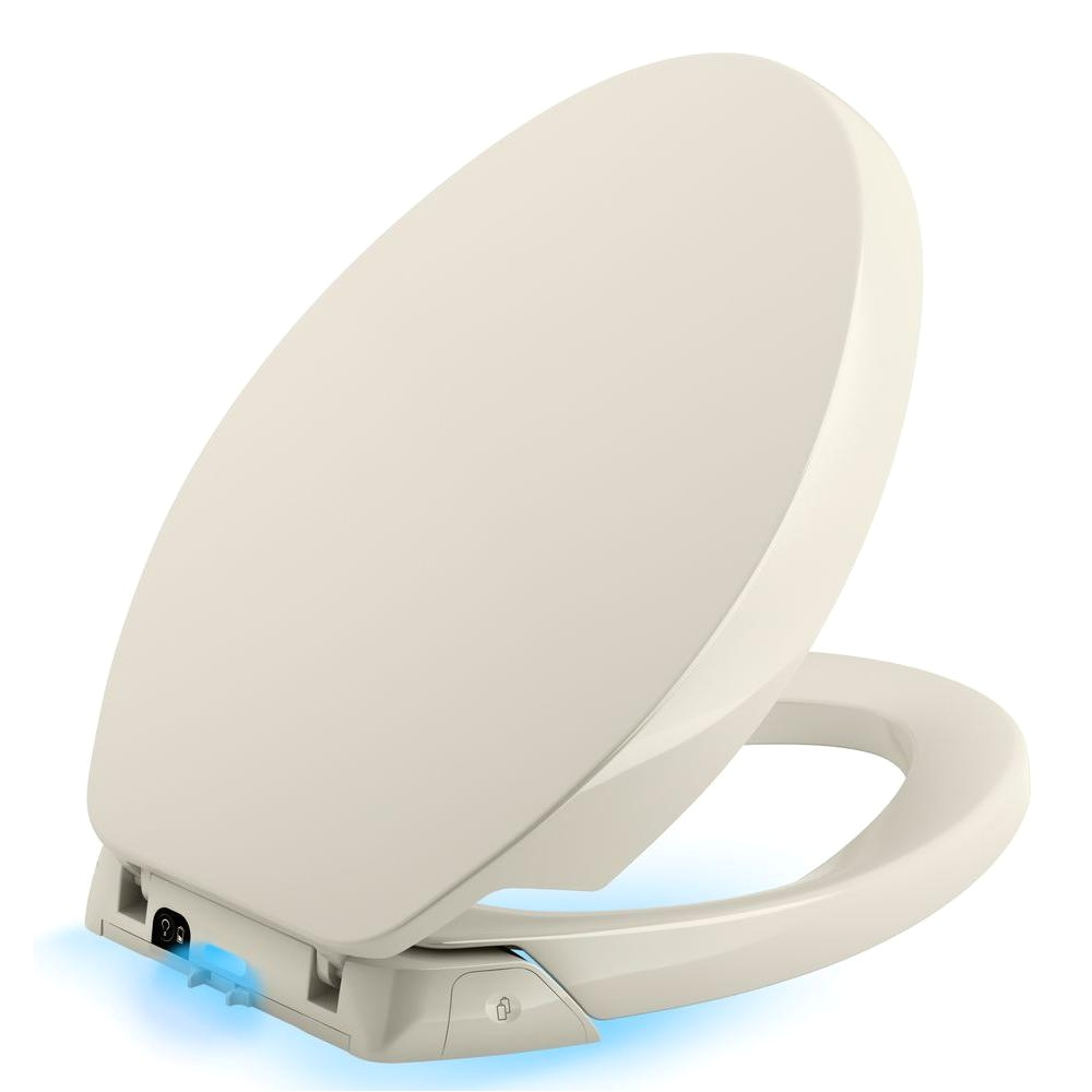 kohler purefresh elongated closed front toilet seat in biscuit