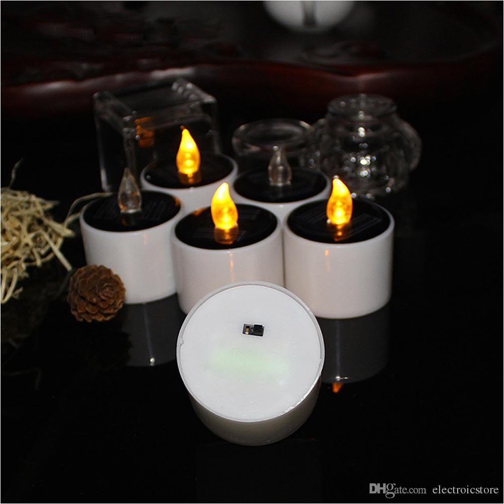 led flameless candle solar powered led candle lamp yellow tea light wedding party home decoration warm white led auto led spot light from electroicstore