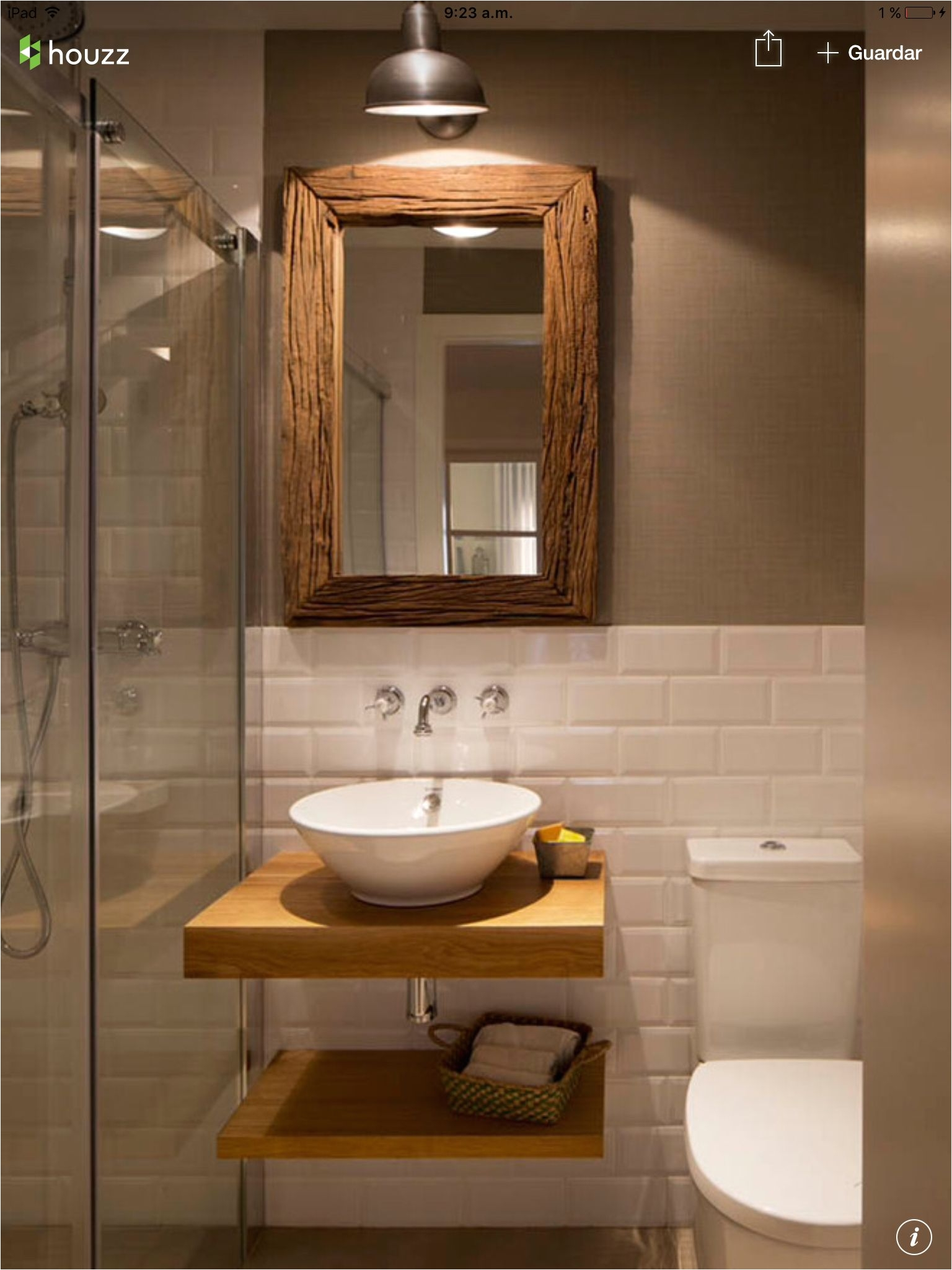 Half white tiles with contrast brown wall and white and brown bathroom fixtures and accents