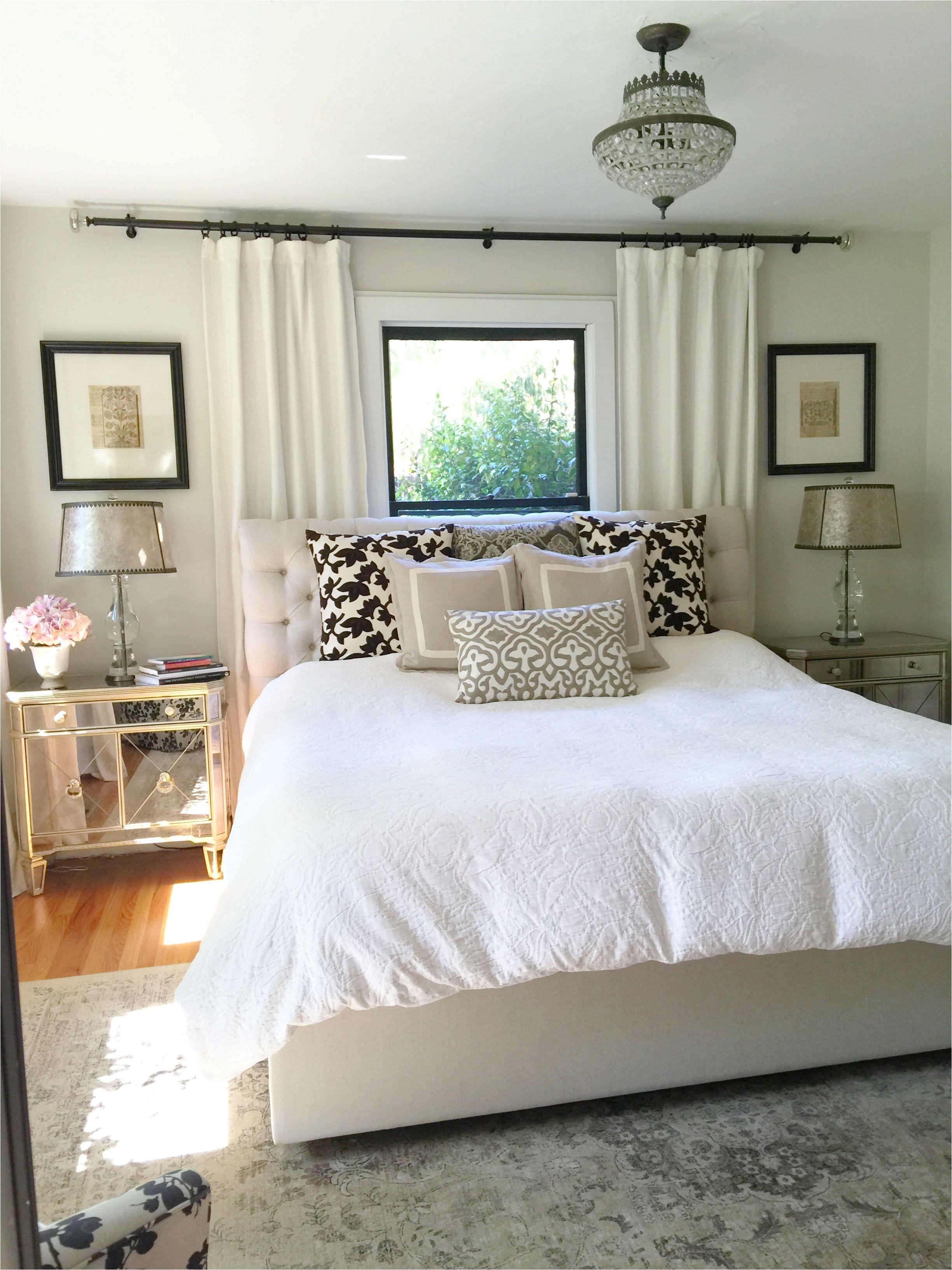 Neutral bedroom Window behind bed Bedroom window treatments Paint is Benjamin Moore winds breath