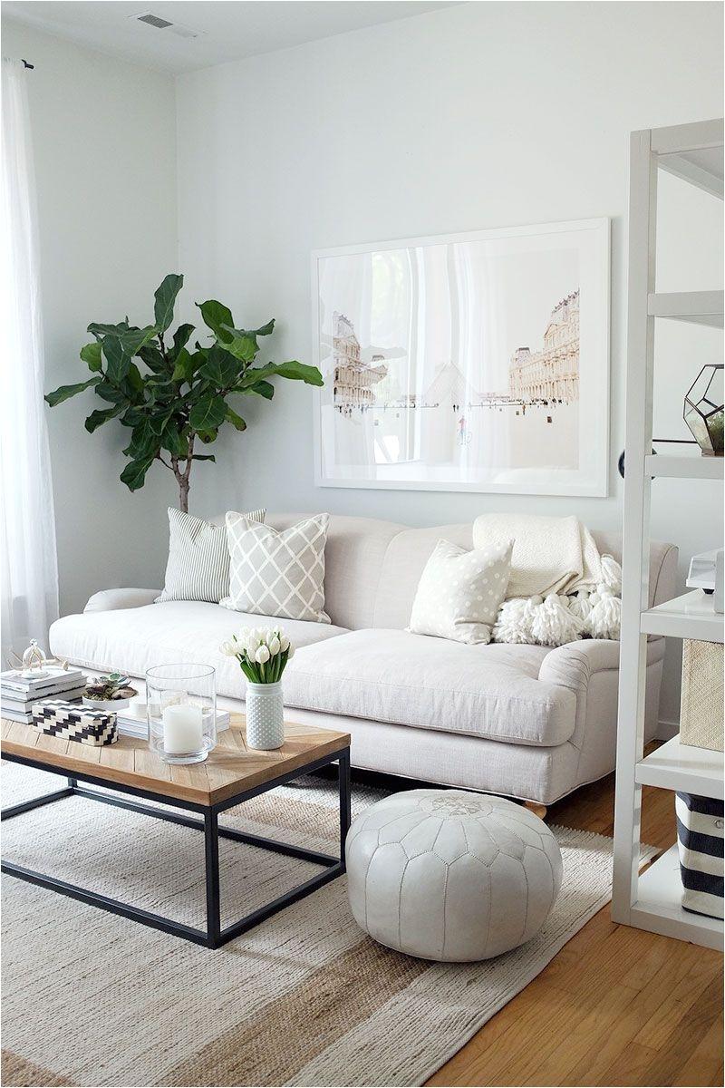 neutral living room English roll arm sofa oversized art