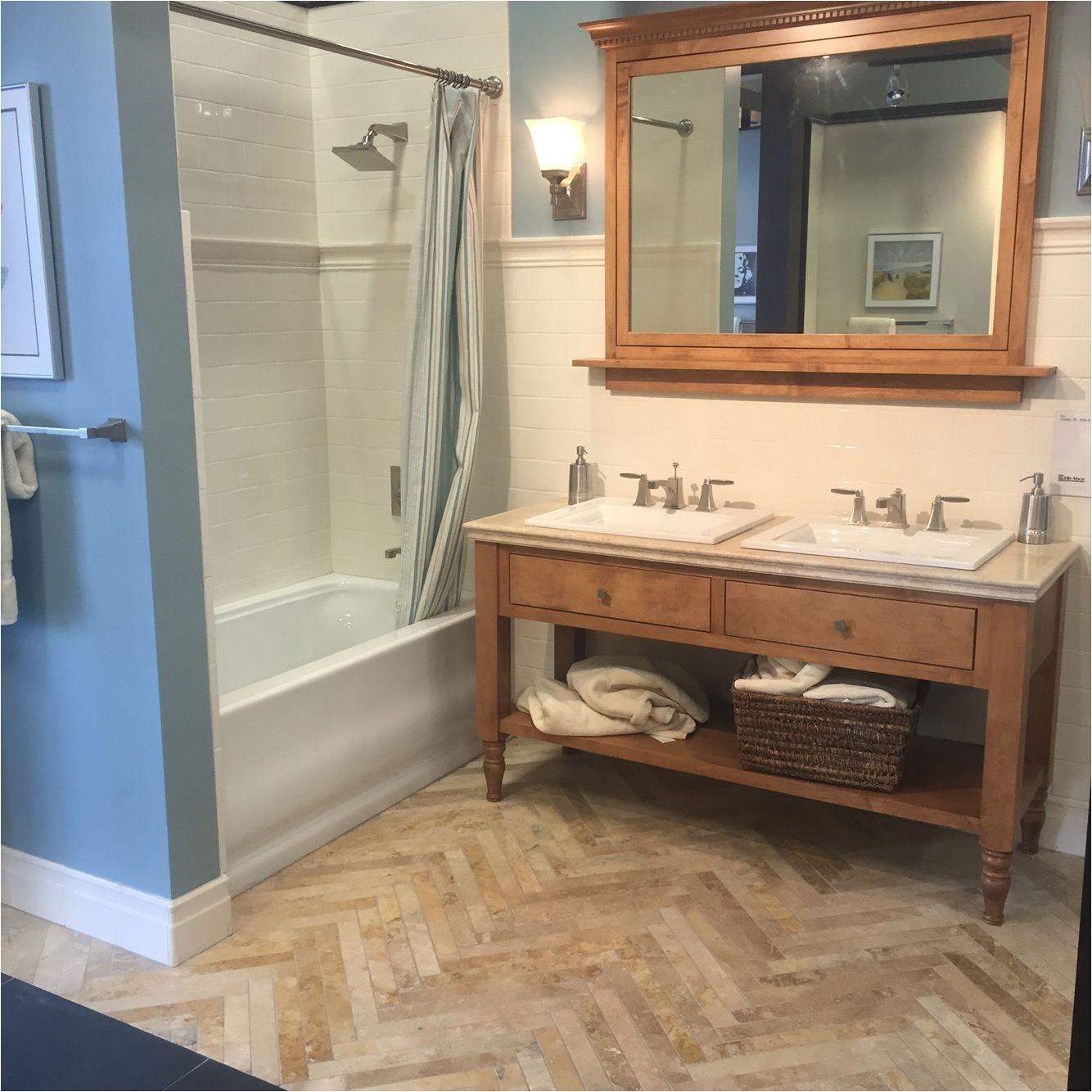Beautiful neutral bathroom with wood and travertine tile vanity herringbone travertine floor tiles