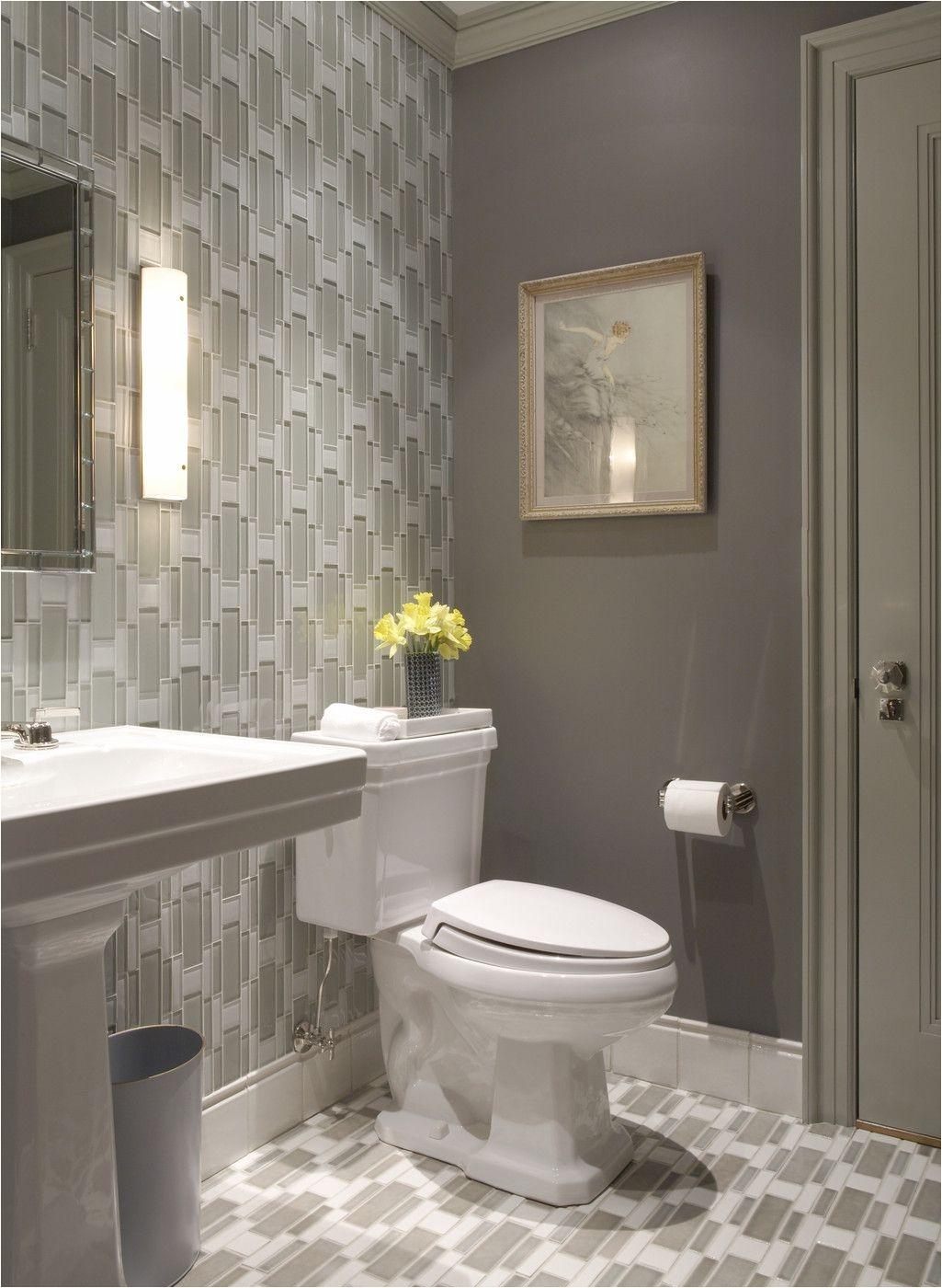 Warm neutrals in a sleek bathroom Gray Bathroom Walls Bathroom Niche Half Bathroom Decor