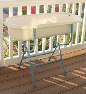 very unusual antique enamel baby bathtub on stand