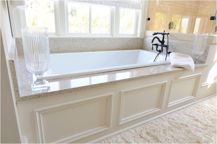 Bathtub Granite Surround Traditional Master Bathroom with White Underscore