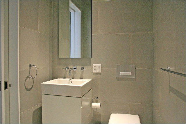 Concrete wall panels and batchroom floor modern bathroom tile new york