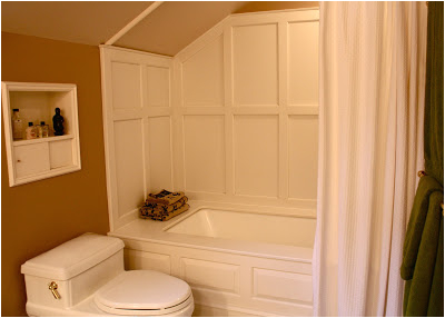 bathtub surround paneled with corian