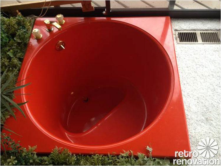 red round sunken kohler bath tub